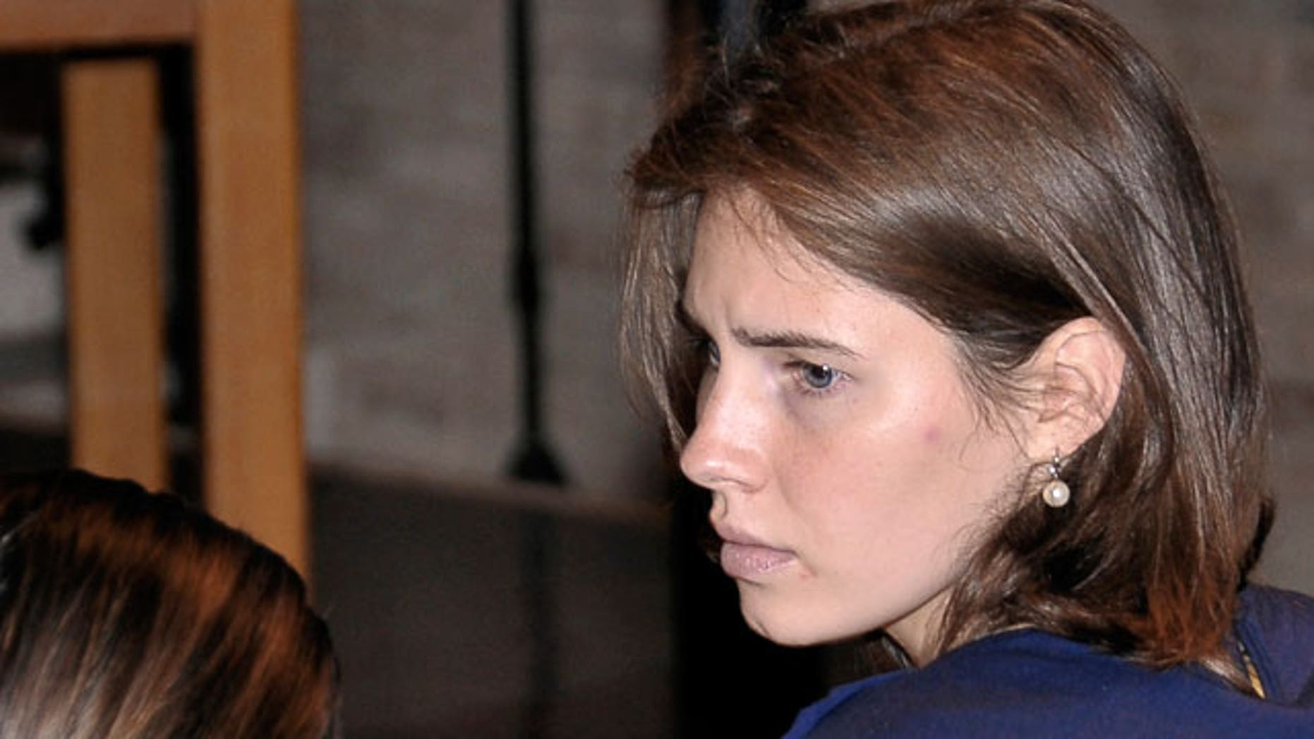 Amanda Knox looks on during her appeal trial in Perugia, Italy, Saturday, June 18, 2011. Knox was convicted of murdering her British roommate in Perugia, Meredith Kercher, and sentenced to 26 years in prison. Her co-defendant and ex-boyfriend Raffaele Sollecito was also convicted and sentenced to 25 years. They both deny wrongdoing and have appealed the 2009 verdict.