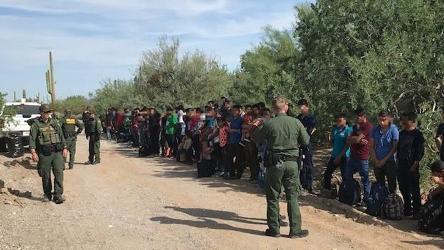 Border Patrol authorities say 128 immigrants believed abandoned by smugglers in a remote desert area at the Arizona border with Mexico are facing deportation.