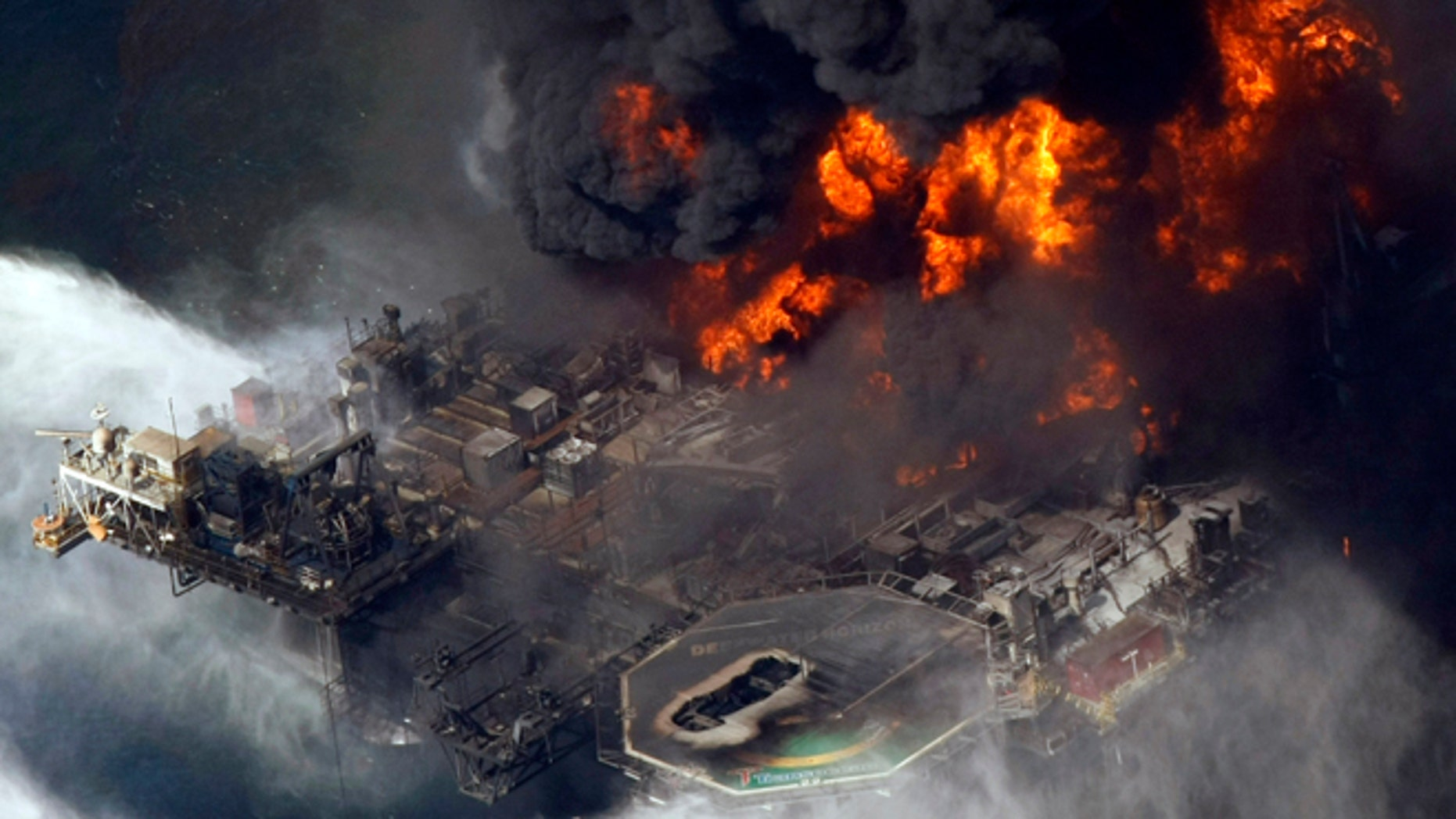 April 21, 2010: In this aerial file photo taken in the Gulf of Mexico more than 50 miles southeast of Venice, La., the Deepwater Horizon oil rig is seen burning.