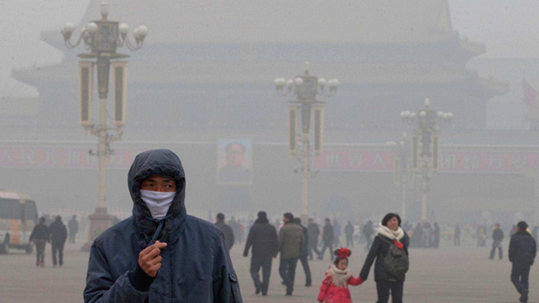 Jan. 29, 2013: A man wears a mask on Tiananmen Square in thick haze in Beijing.