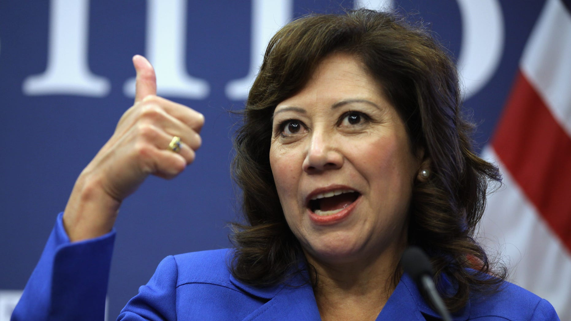 """WASHINGTON, DC - OCTOBER 20:  U.S. Labor Secretary Hilda Solis gives a thumbs-up during a news conference to announce a partnership between Facebook, the National Association of Colleges and Employers, DirectEmployers Association and the National Association of State Workforce Agencies aimed at connecting Americans with jobs October 20, 2011 in Washington, DC. """"By leveraging the power of the social Web, this initiative will provide immediate, meaningful and ready-to-use information for job seekers and employers,"""" Solis said.  (Photo by Chip Somodevilla/Getty Images)"""
