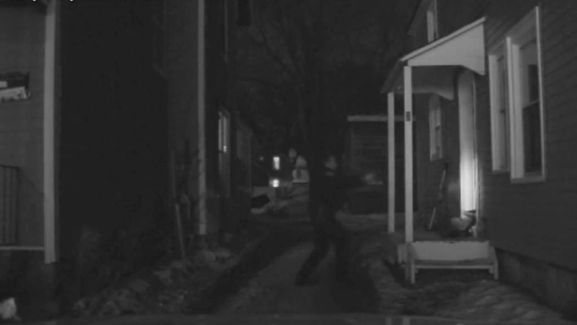 In this March 6, 2015 frame from Madison Police dash camera video released by Wisconsin State Justice Department, Officer Matt Kenny backs away from the door after shooting inside an apartment in Madison, Wis. The officer won't be charged for fatally shooting an unarmed 19-year-old biracial man, Tony Robinson, a prosecutor announced Tuesday, May 12, 2015. (Madison Police Department via AP)