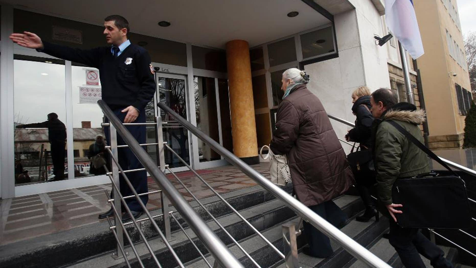Family members of killed Bosnian Muslim men and boys arrive at the special court building in Belgrade, Serbia, Monday, Dec. 12, 2016. Eight former Bosnian Serb special police troops went on trial Monday in Serbia charged with taking part in the massacre of thousands of Muslims in Srebrenica in 1995 - a landmark proceedings testing the Balkan country's proclaimed pledge to deal with its wartime past. (AP Photo/Darko Vojinovic)