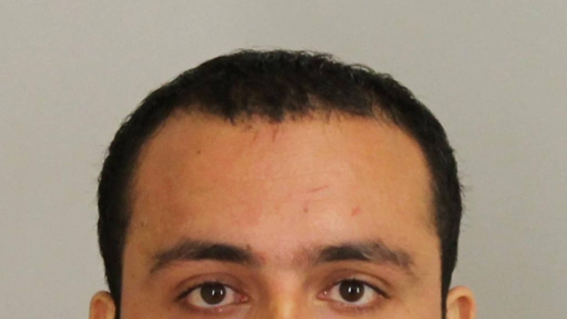 FILE - This Sept.2016 file photo provided by Union County Prosecutor's Office shows Ahmad Khan Rahami.  The sister of a Rahami, the man charged with setting off bombs in New York and New Jersey and injuring 31 people this month, says he was getting ready to hit her with a dumbbell in August 2014 and stabbed another brother who came to her aid.(Union County Prosecutor's Office via AP, File)