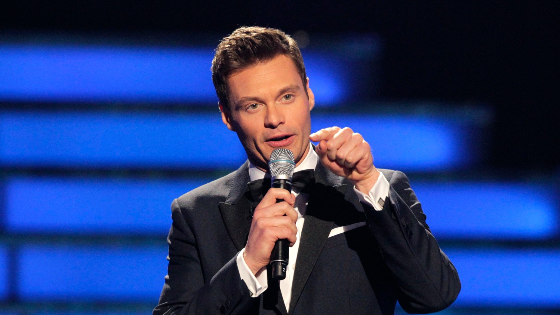 """Host Ryan Seacrest presides over the 11th season finale of """"American Idol"""" in Los Angeles, California, May 23, 2012."""