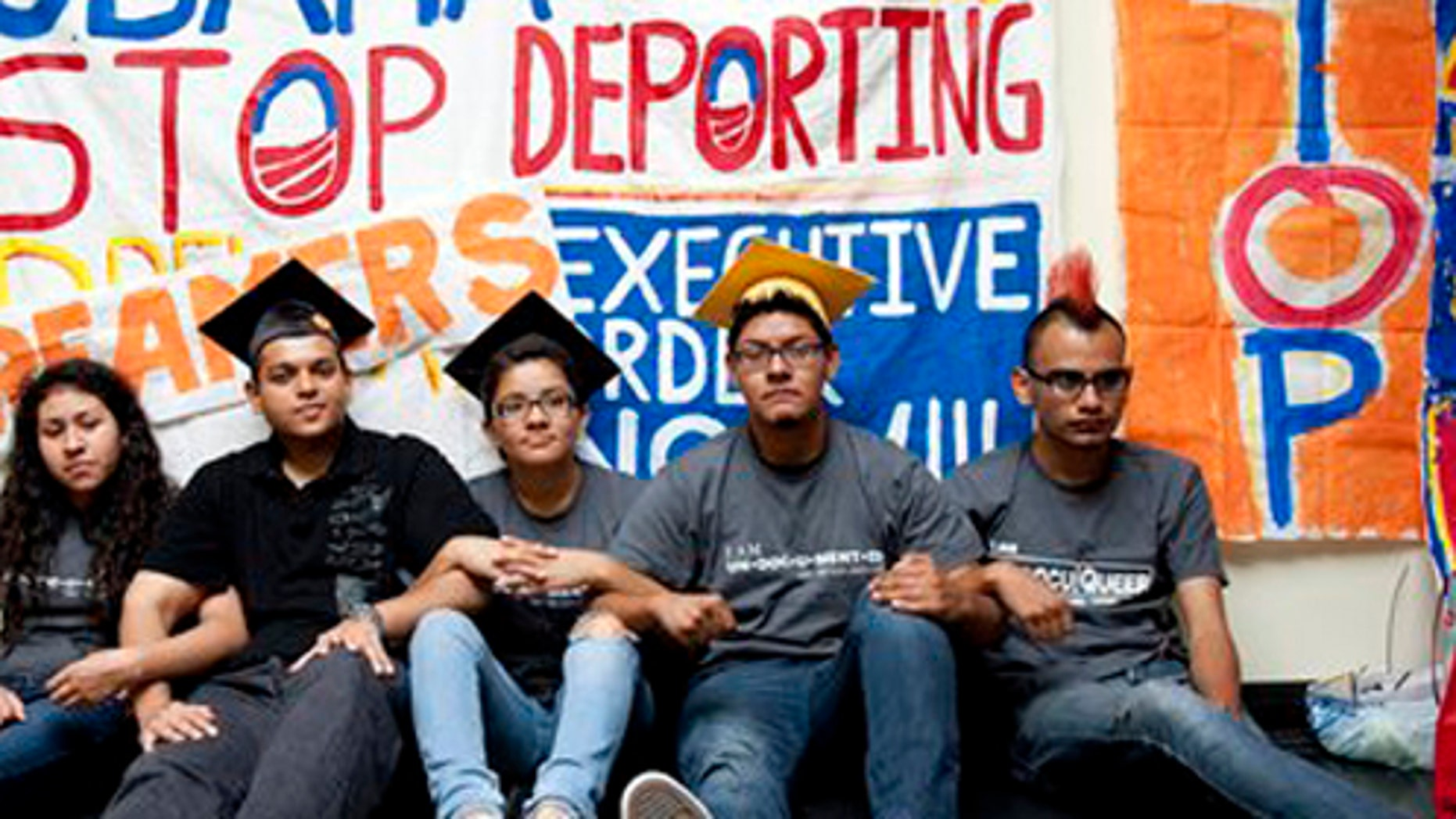 From left, Myisha Areloano, Adrian James, Jahel Campos, David Vuenrostro, and Antonio Cabrera camp outside of the Obama Campaign Headquarters in Culver City, Calif. in protest of President Obama's immigration policiesand in hopes of getting him to pass an executive order to halt discretionary deportation on Friday, June 16, 2012. President Obama eased enforcement of immigration laws Friday, offering a chance for hundreds of thousands of illegal immigrants to stay in the country and work. Immediately embraced by Hispanics, the extraordinary step touched off an election-year confrontation with congressional Republicans.  (AP Photo/Grant Hindsley)