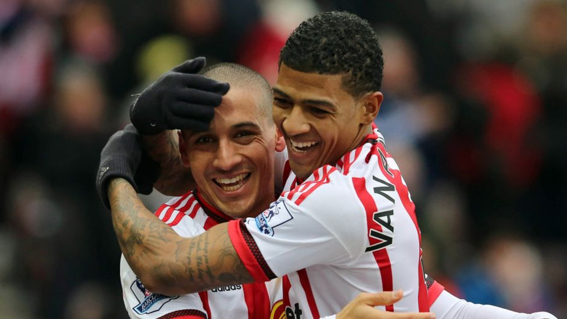 SUNDERLAND, UNITED KINGDOM - FEBRUARY 13: Wahbi Khazri of Sunderland (L) celebrates the first goal with Patrick Van Aanholt during the Barclays Premier match between Sunderland and Manchester United at the Stadium of Light on February 13, 2016 in Sunderland, England. (Photo by Ian Horrocks - Sunderland AFC via Getty Images)