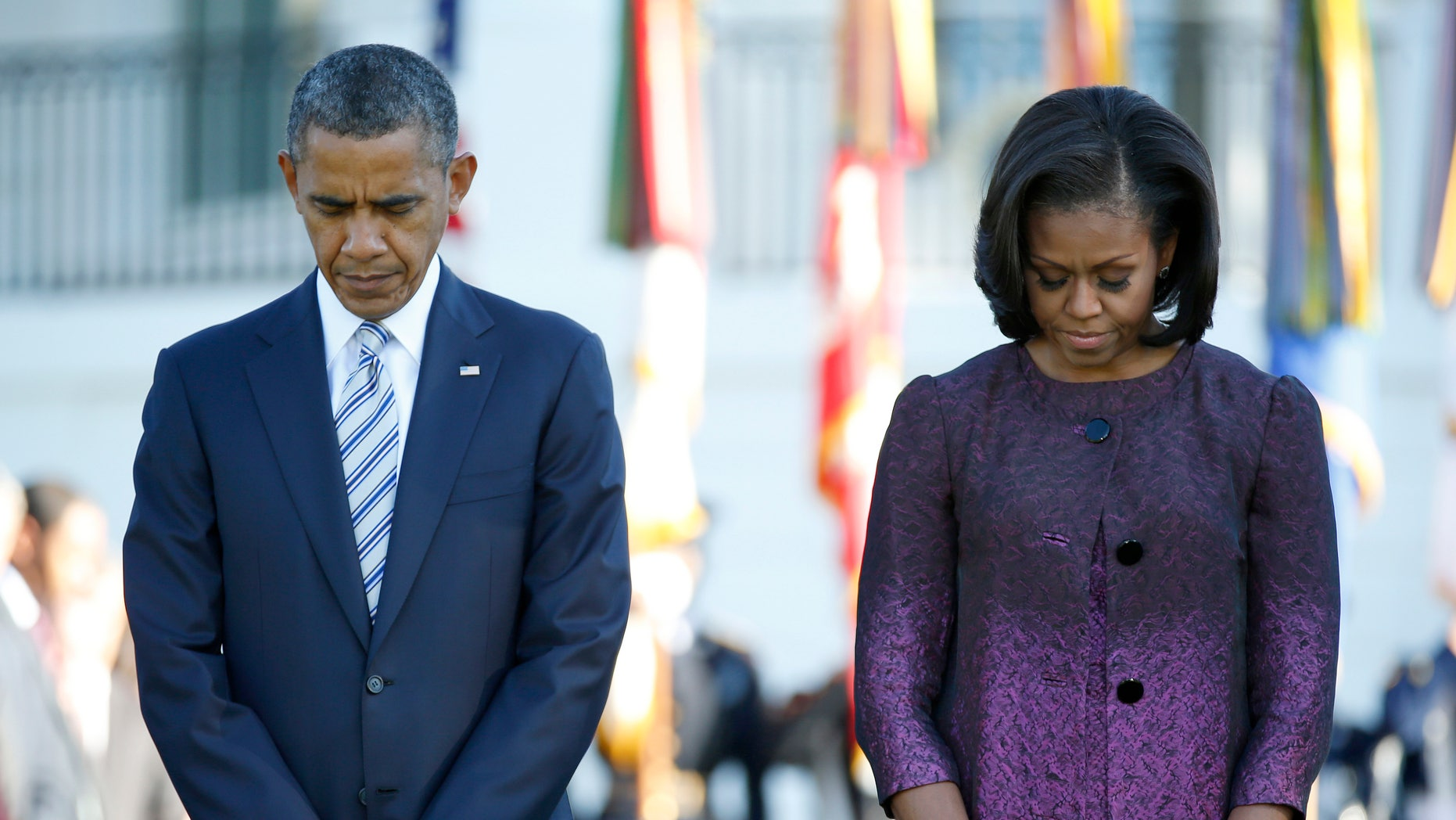 FILE: Sept. 11, 2012: President Obama and first lady Michelle Obama mark the 11th anniversary of the 9-11 attacks, on the South Lawn of the White House in Washington, D.C.