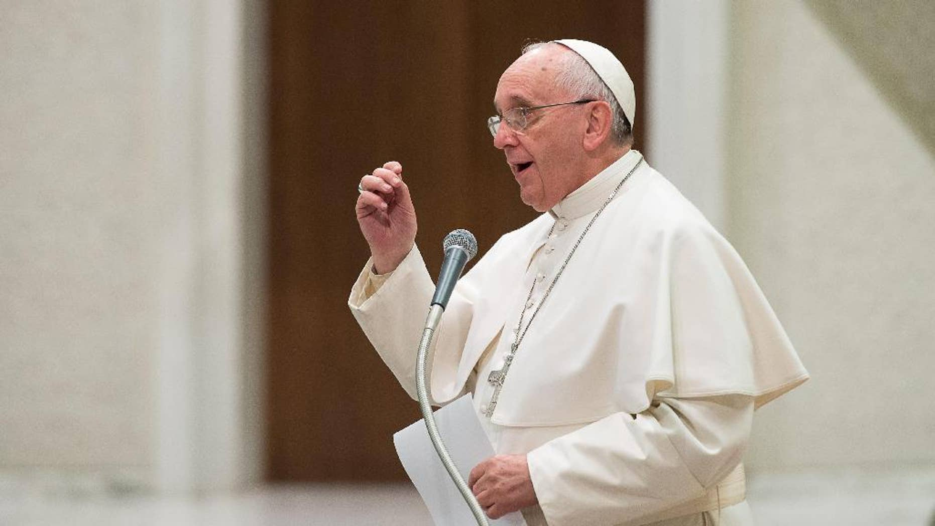 Pope Francis delivers his message on the occasion of an audience granted to members of the Italian Confcooperative, cooperative associations, in the Paul VI hall at the Vatican, Saturday, Feb. 28, 2015. (AP Photo/L'Osservatore Romano, Pool)