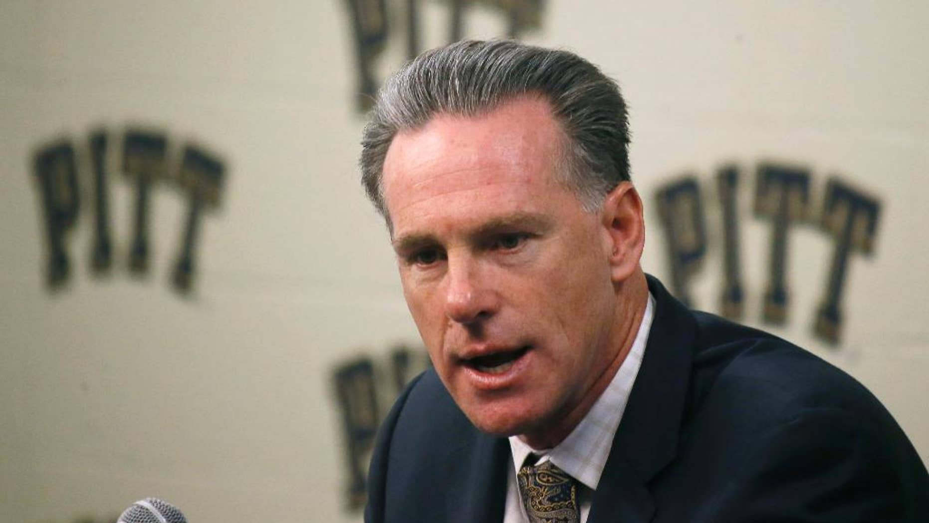 FILE - In this Oct. 2, 2014, file photo, Pittsburgh's NCAA college basketball head coach Jamie Dixon takes questions during the school's annual media day in Pittsburgh. Dixon believes Pitt will score points. His biggest concern is whether the Panthers will stop anybody as they prepare for their second season in the ACC.  (AP Photo/Keith Srakocic, File)