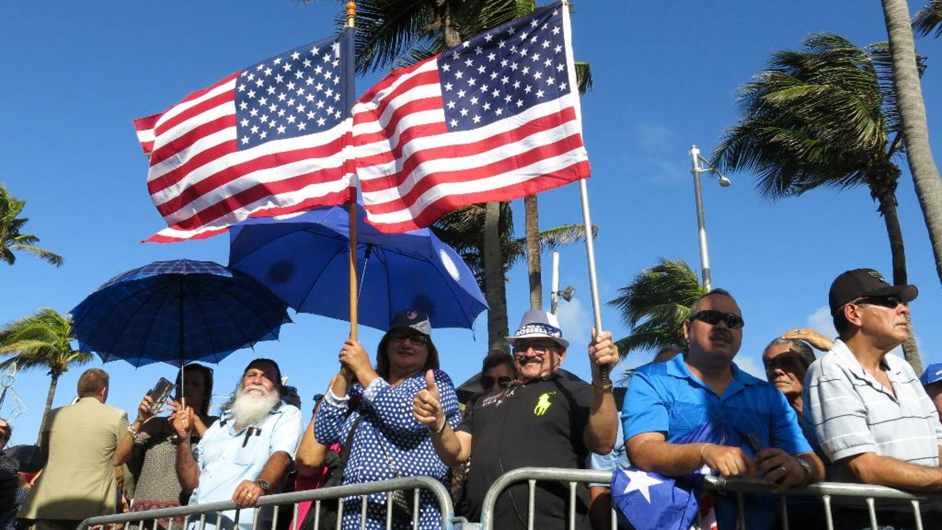 Pro-statehood supporters await the arrival of Puerto Rico's new governor at the seaside Capitol in San Juan, Puerto Rico, Monday, Jan. 2, 2017.  Ricardo Rossello was sworn in Monday as the U.S. territory prepares for what many believe will be new austerity measures and a renewed push for statehood to haul the island out of a deep economic crisis. (AP Photo/Danica Coto)