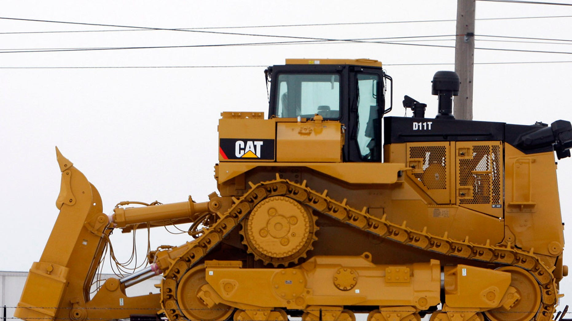 A bulldozer sits on a railcar outside the Caterpillar plant in Peoria, Illinois