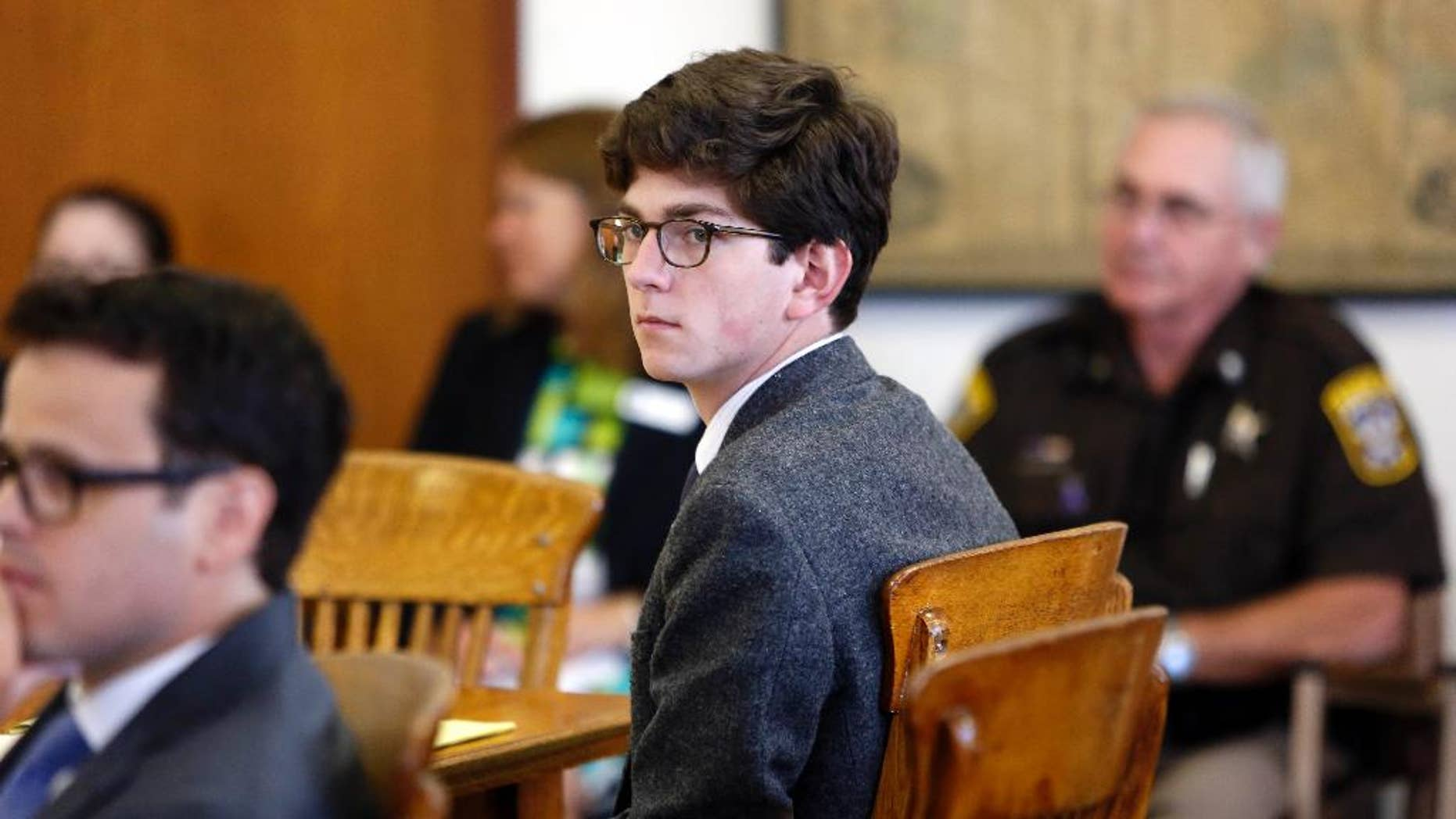 FILE - In this Tuesday Aug. 18, 2015 file photo, St. Paul's School student Owen Labrie looks around the courtroom at the start of his trial. Labrie was convicted of sexually assaulting a 15-year-old freshman girl as part of a game of sexual conquest. Labrie's new lawyer has submitted arguments for a new trial, saying the emails between Labrie and the 15-year-old girl don't support his computer crime conviction because they were hosted by an intranet server, an weren't sent through the internet, AP Photo/Jim Cole, File)
