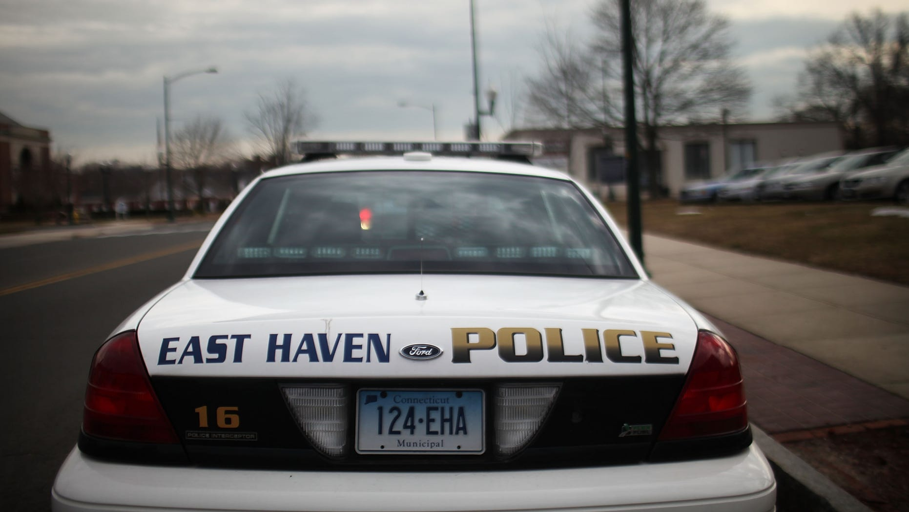 EAST HAVEN, CT - FEBRUARY 01:  An East Haven Police car is viewed on February 1, 2012 in East Haven, Connecticut. Following an investigation by the FBI, four East Haven police officers were arrested last week and accused of abusing Latinos in the working class community of 28,000 people which was nearly predominately white a generation ago. A recent civil rights investigation which was released last month revealed a pattern of discriminatory policing East Haven and the town has been warned by the U.S. Justice Department to make reforms. The arrested officers have been accused of subjecting Hispanics to beatings and false arrests among other things. Currently East Haven's Latino population is around 10 percent.  (Photo by Spencer Platt/Getty Images)