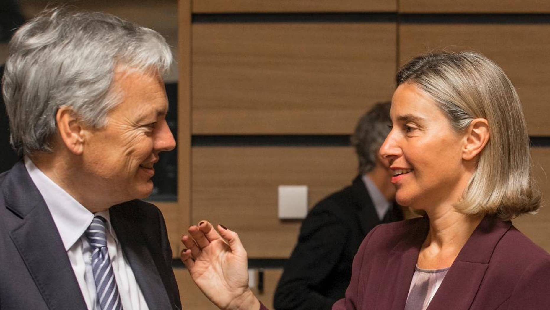 Belgium's foreign minister Didier Reynders, left, speaks with EU Council High representative Federica Mogherini during a meeting of EU foreign ministers at the EU Council building in Luxembourg, Monday, Oct. 17, 2016. European Union foreign ministers debated Monday whether to extend sanctions against the Syrian regime as political efforts to secure a cease-fire and access for humanitarian aid falter. (AP Photo/Olivier Matthys)