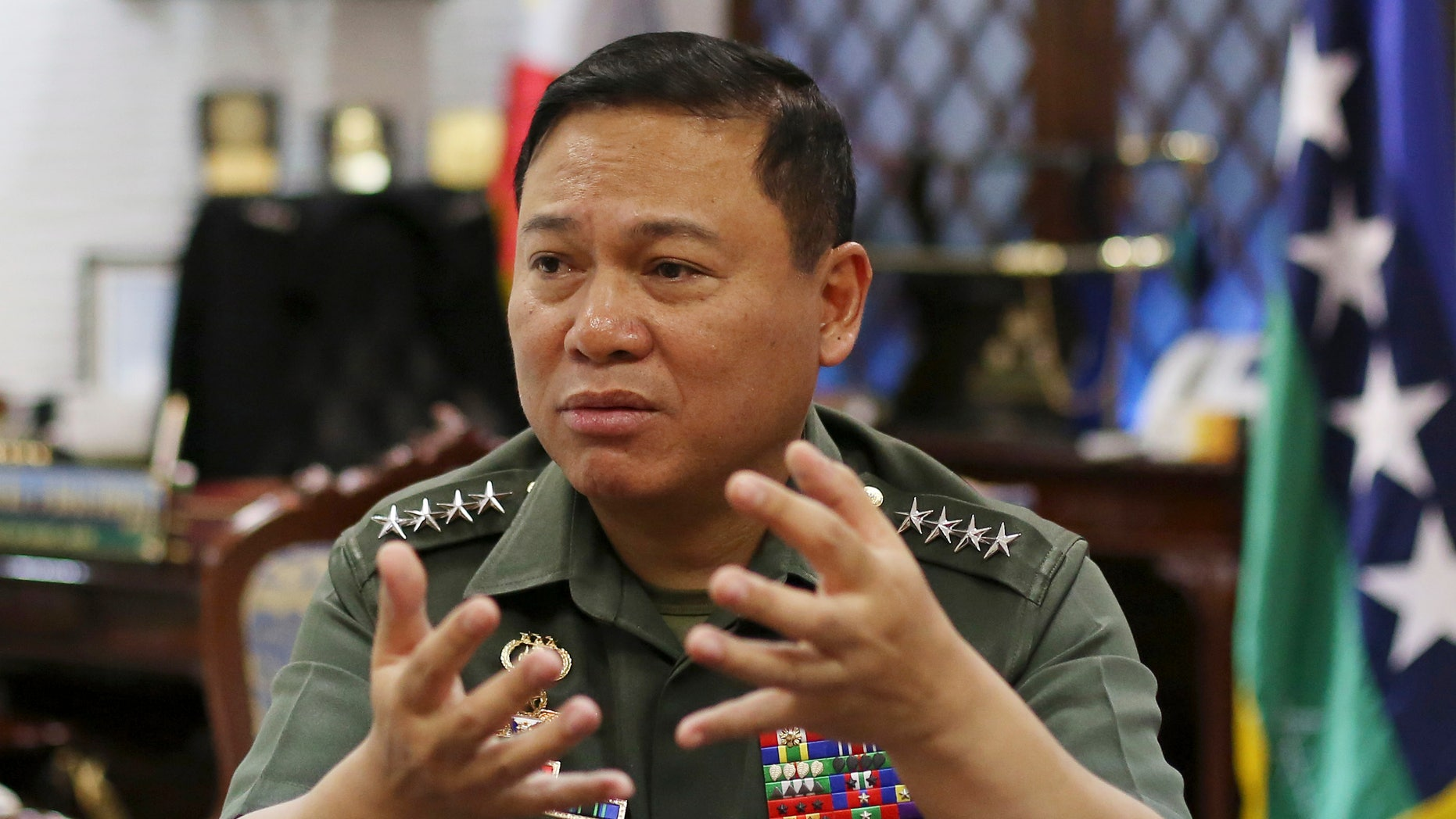 "Philippine Military Chief Emmanuel Bautista gestures during an interview at Camp Aquinaldo military headquarters in suburban Quezon city, north of Manila, Philippines on Thursday, Feb. 20, 2014. Bautista says Beijing's territorial claims in the South China Sea are ""nonsense"" and vowed to defend fishermen if they face intimidation by Chinese naval forces in the waters. (AP Photo/Aaron Favila)"