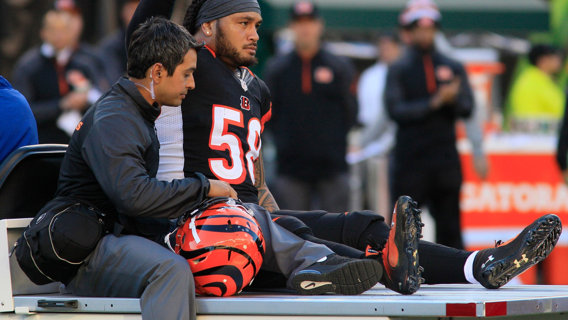 Cincinnati Bengals middle linebacker Rey Maualuga is taken off the field after being injured in the first half of an NFL football game against the New York Jets, Sunday, Oct. 27, 2013, in Cincinnati. (AP Photo/Tom Uhlman)