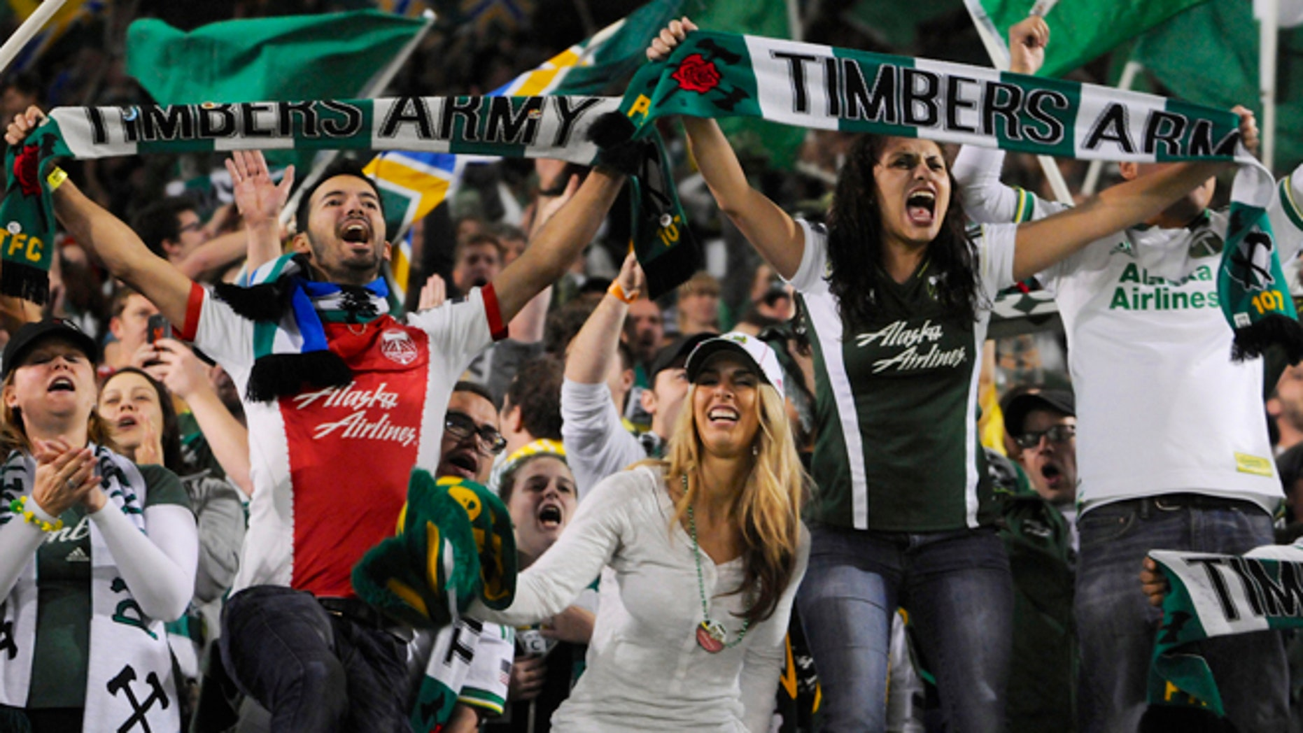 Portland Timbers' fans celebrate the win against Seattle in an MLS Soccer game in Portland, Ore, on Oct. 13, 2013.