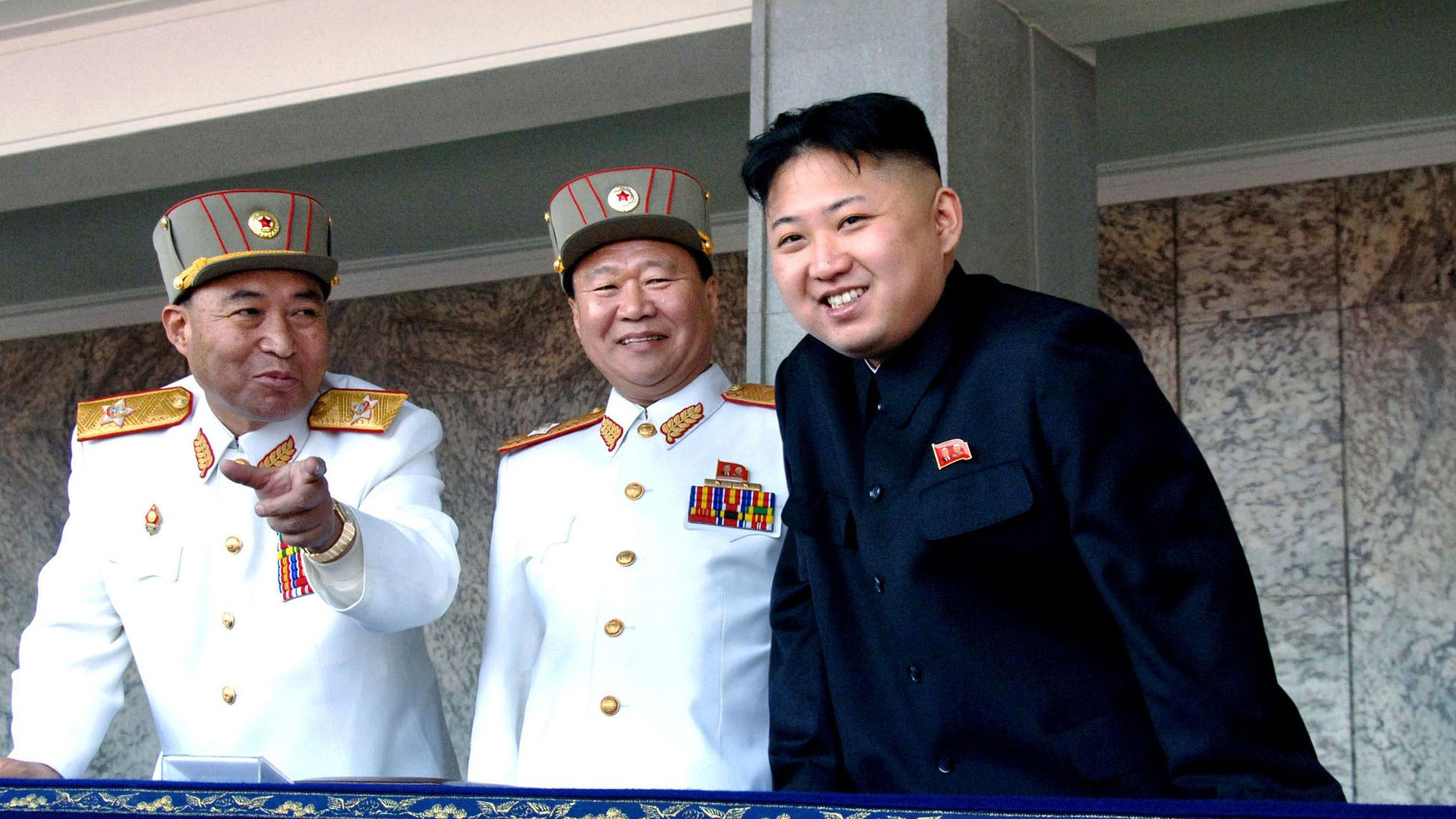 FILE: Undated: North Korean leader Kim Jong Un, (r.), with the Korean People's Army senior officers, preparing a satellite launch.