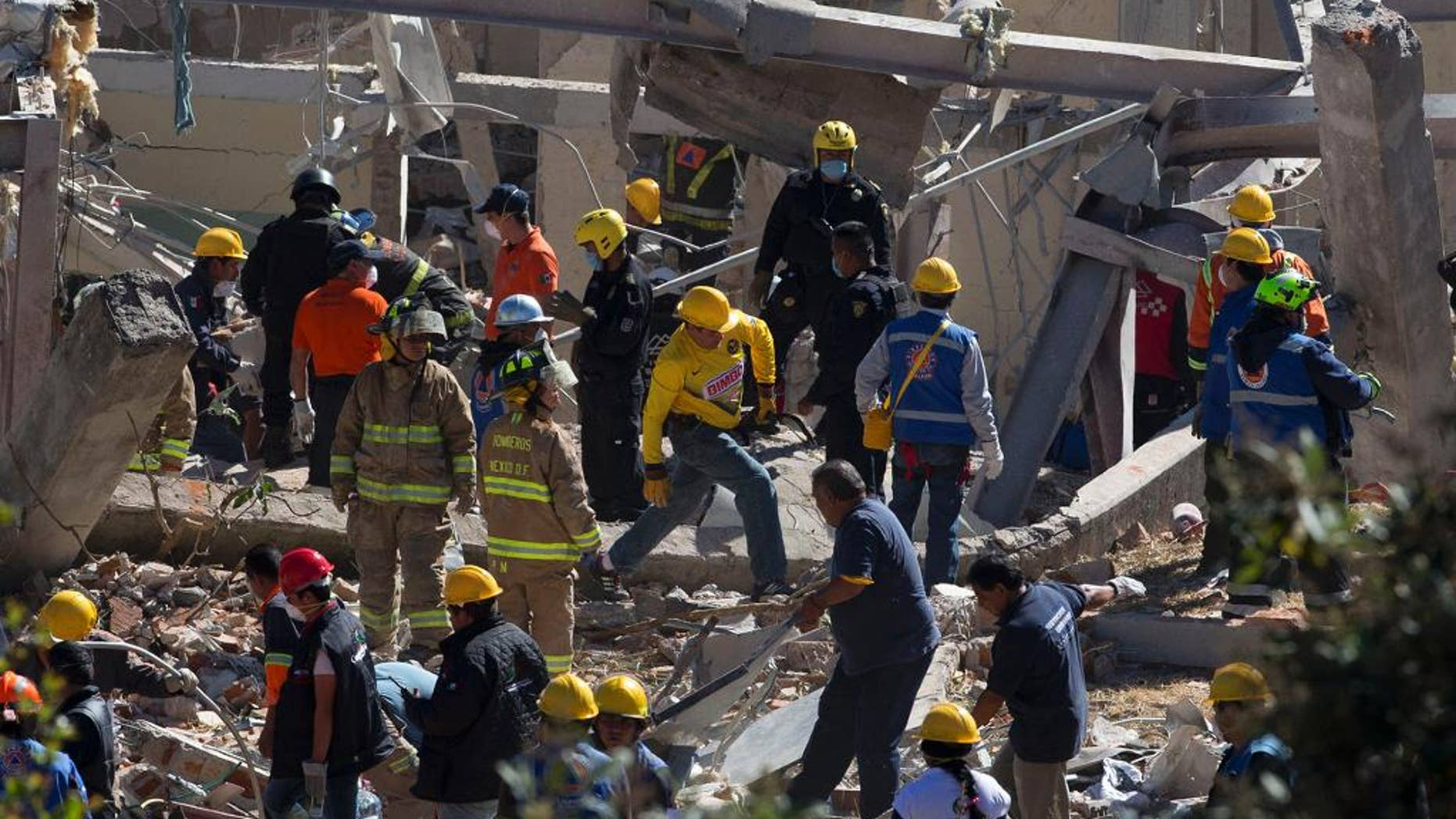 Jan. 29, 2015: Search and rescue workers comb through the rubble of a maternity hospital which collapsed when a gas tank truck exploded outside the hospital, in Cuajimalpa on the western edge of Mexico City. (AP)