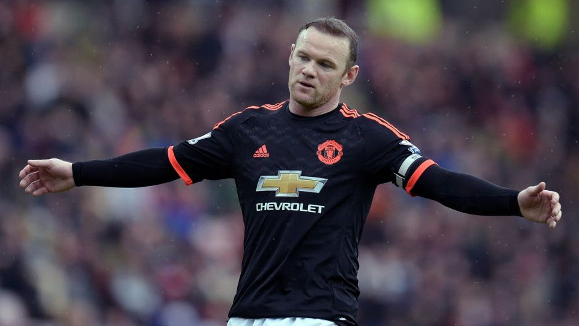 Manchester United's English striker Wayne Rooney reacts during the English Premier League football match between Sunderland and Manchester United at the Stadium of Light in Sunderland, northeast England on February 13, 2016. / AFP / OLI SCARFF / RESTRICTED TO EDITORIAL USE. No use with unauthorized audio, video, data, fixture lists, club/league logos or 'live' services. Online in-match use limited to 75 images, no video emulation. No use in betting, games or single club/league/player publications. / (Photo credit should read OLI SCARFF/AFP/Getty Images)