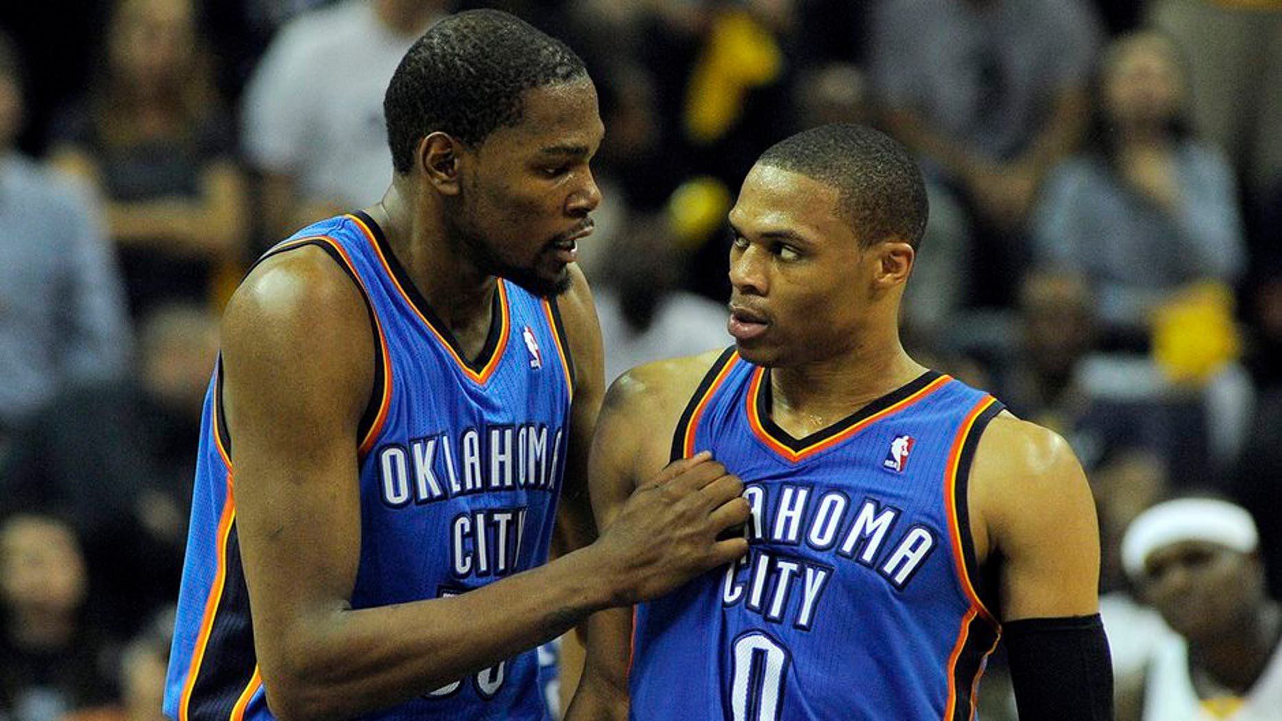 Apr 24, 2014; Memphis, TN, USA; Oklahoma City Thunder forward Kevin Durant (35) and guard Russell Westbrook (0) talk during the game against the Memphis Grizzlies in game three of the first round of the 2014 NBA Playoffs at FedExForum. Memphis Grizzlies beat Oklahoma City Thunder in overtime 98 - 95. Mandatory Credit: Justin Ford-USA TODAY Sports