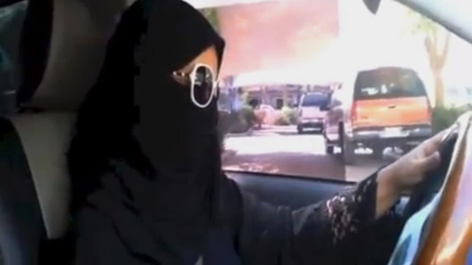Oct. 26, 2013: In this image made from video provided by the Driving campaign, which has been authenticated based on its contents and other AP reporting, a Saudi woman drives a vehicle in Riyadh, Saudi Arabia.