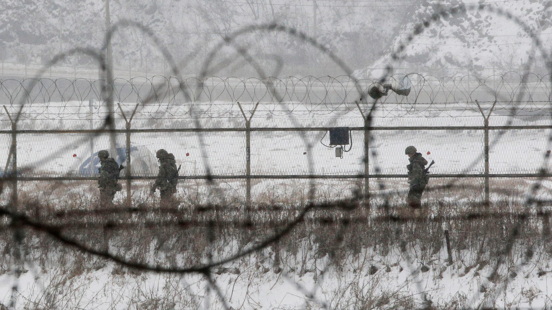 Feb. 12, 2013: South Korean army soldiers patrol along barbed-wire fences at the Imjingak Pavilion, near the demilitarized zone of Panmunjom, in Paju, South Korea.
