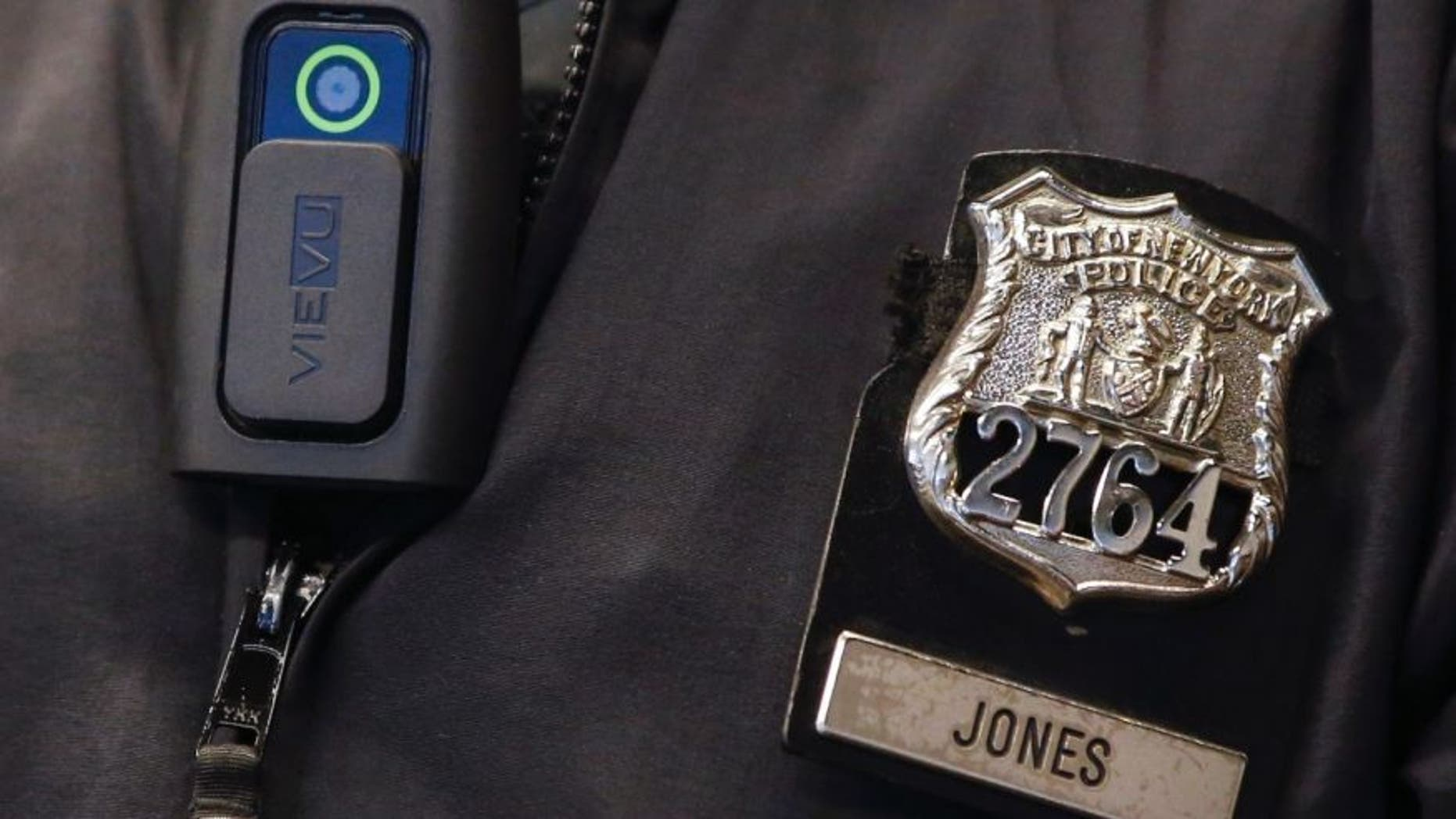 Dec. 3, 2014: A police body camera is seen on an officer during a news conference.