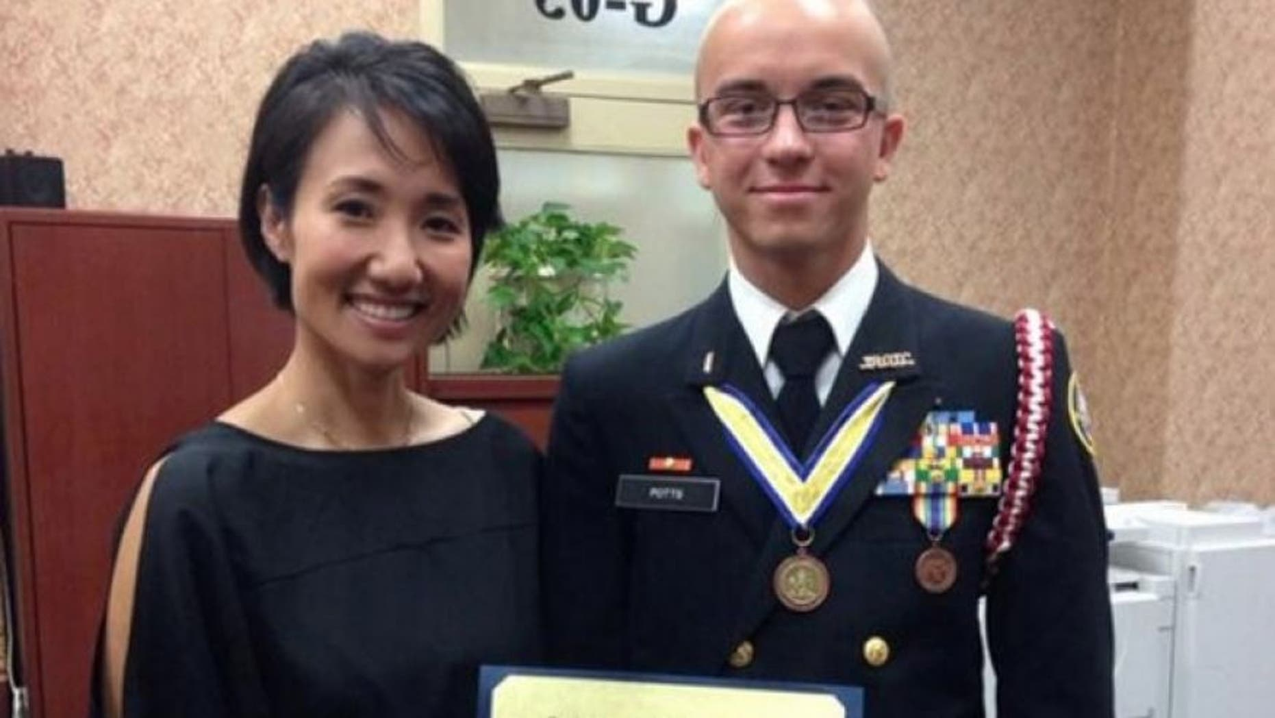 Artur Samarin, 23, was photographed with Rep. Patty Kim after he was inducted into the National Honor Society