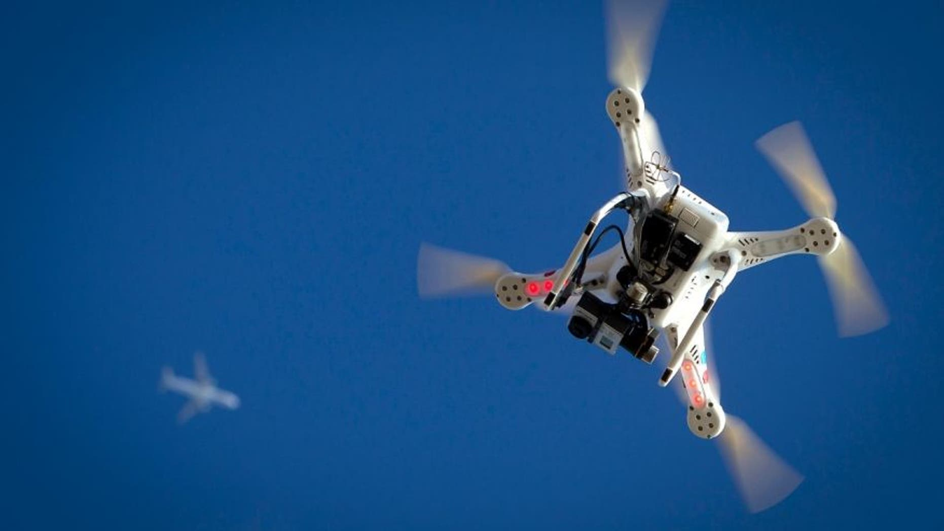 Jan. 1, 2015: An airplane flies over a drone during the Polar Bear Plunge on Coney Island in the Brooklyn borough of New York.