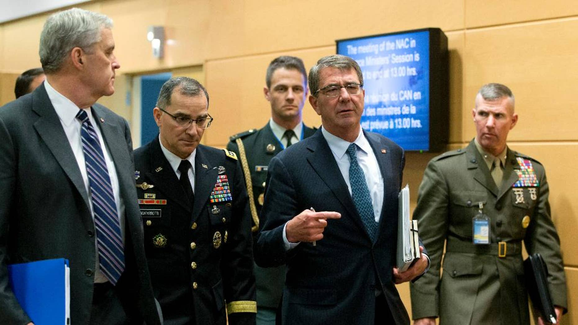 June 15, 2016: U.S. Secretary of Defense Ash Carter, second right, walks with members of his delegation prior to a meeting at NATO headquarters in Brussels.