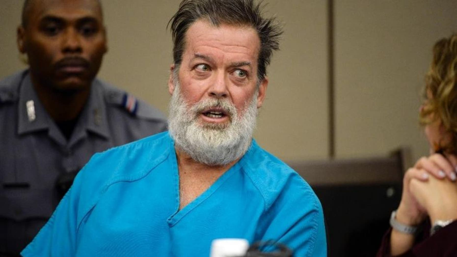 Dec. 9, 2015: Robert Lewis Dear, middle, talks during a court appearance in Colorado Springs, Colo.