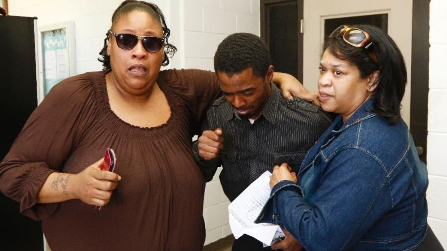 May 24, 2016: An emotional Joshua Blunt, center, is surrounded by family members after being released from the Grenada County Jail in Grenada, Miss