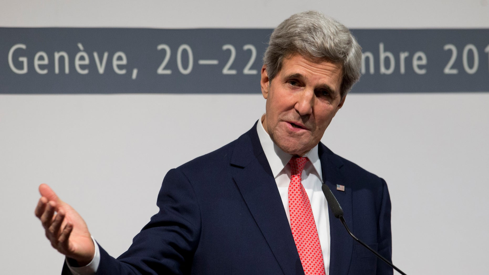 U.S. Secretary of State John Kerry gestures as he speaks to the media about the deal that has been reached between six world powers and Iran that calls on Tehran to limit its nuclear activities in return for sanctions relief,  at the International Conference Centre of Geneva, Sunday, Nov. 24, 2013, in Geneva, Switzerland,  (AP Photo/Carolyn Kaster, Pool)