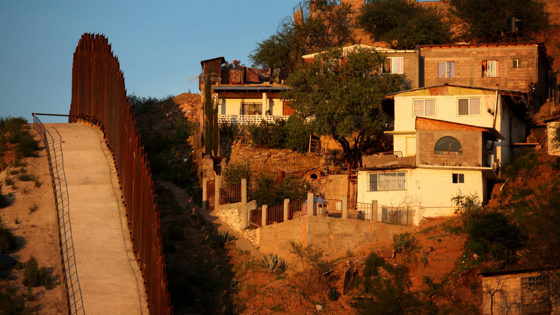 NOGALES, AZ - JULY 6:  The border wall between the U.S. and Mexico is seen July 6, 2012 in Nogales, Arizona. The president-elect of Mexico, Enrique Peña Nieto, stated  that he wants to expand his country's drug-war partnership with the United States but that he would not support the presence of armed American agents in Mexico.  (Photo by Sandy Huffaker/Getty Images)