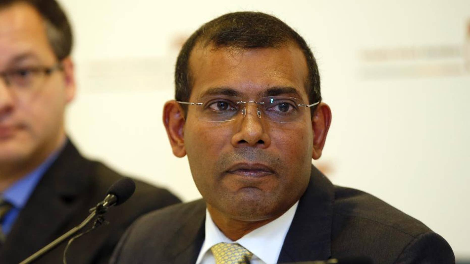 FILE - In a Jan. 25, 2016 file photo, former Maldives president Mohamed Nasheed listens to a question during a press conference in London. The former president of the Maldives said Monday, May 23, 2016, that he's been granted political asylum in Britain where he had traveled for medical treatment on leave from serving a prison sentence in his country. Nasheed, who was the Indian Ocean archipelago's first democratically elected leader, was sentenced to 13 years in prison last year for ordering the arrest of a senior judge while in office.  (AP Photo/Alastair Grant, File)