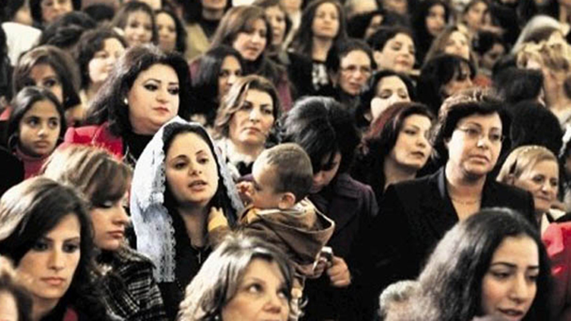 In this AP FILE photo Copts gather to celebrate Christmas in a Cairo Church.