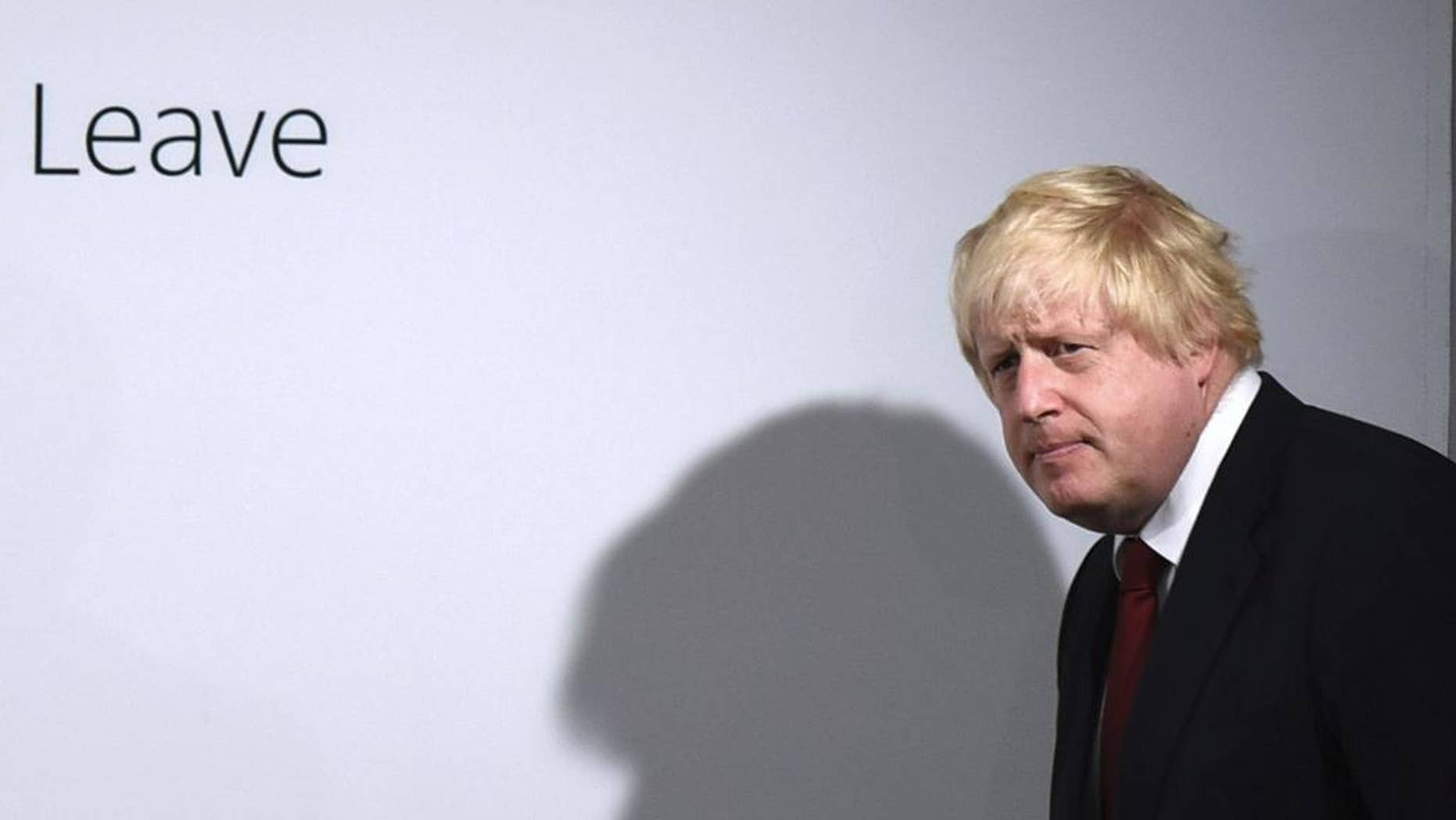 "FILE - In this Friday, June 24, 2016 file photo, Vote Leave campaigner Boris Johnson arrives for a press conference at Vote Leave headquarters in London . In the crucial days before Foreign Secretary Boris Johnson embraced Britain's ""leave campaign,"" he wrote a newspaper column explaining why Britain should remain inside the European Union _ but those forceful words were never published before Britain's June 23 vote. The Sunday Times has now published Johnson's pro-EU column, which outlines his fears about leaving the EU on SUnday, Oct. 16, 2016.  (Mary Turner/Pool via AP, File)"