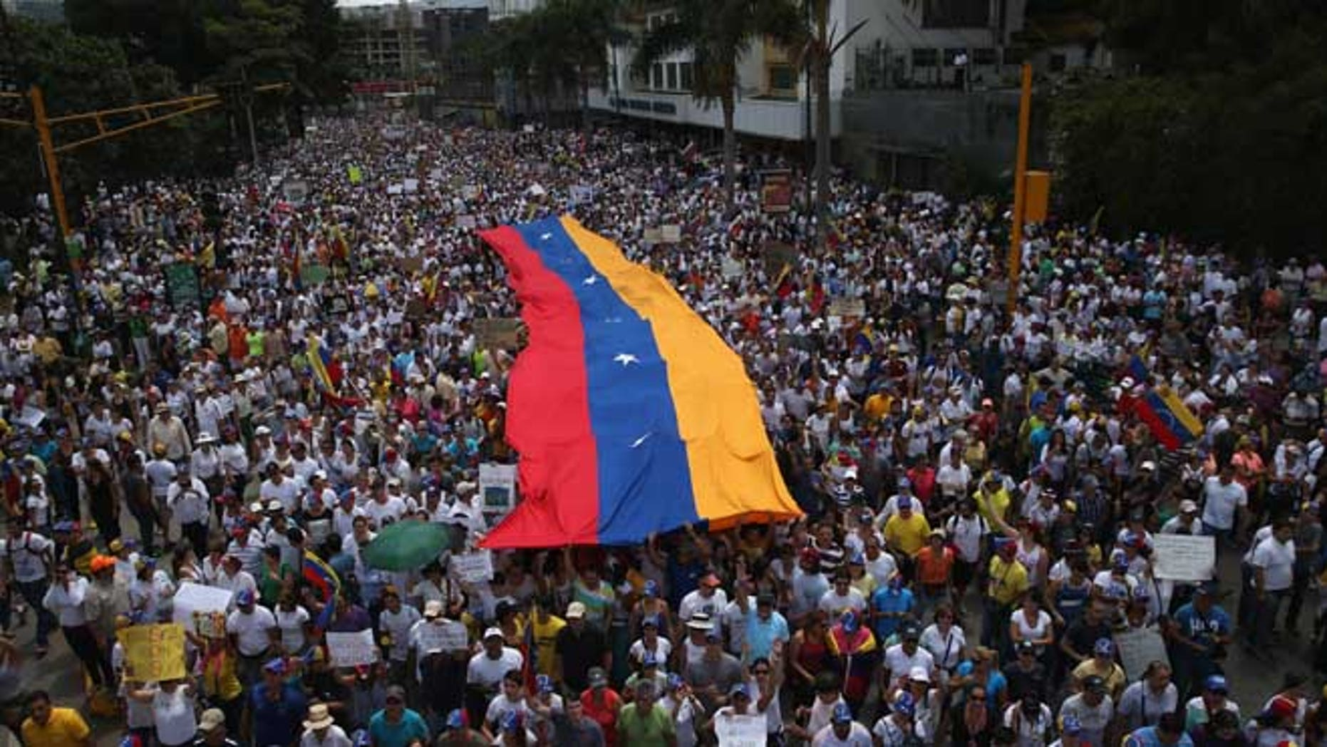 Anti-government protesters in Caracas, Venezuela. (Photo by John Moore/Getty Images)
