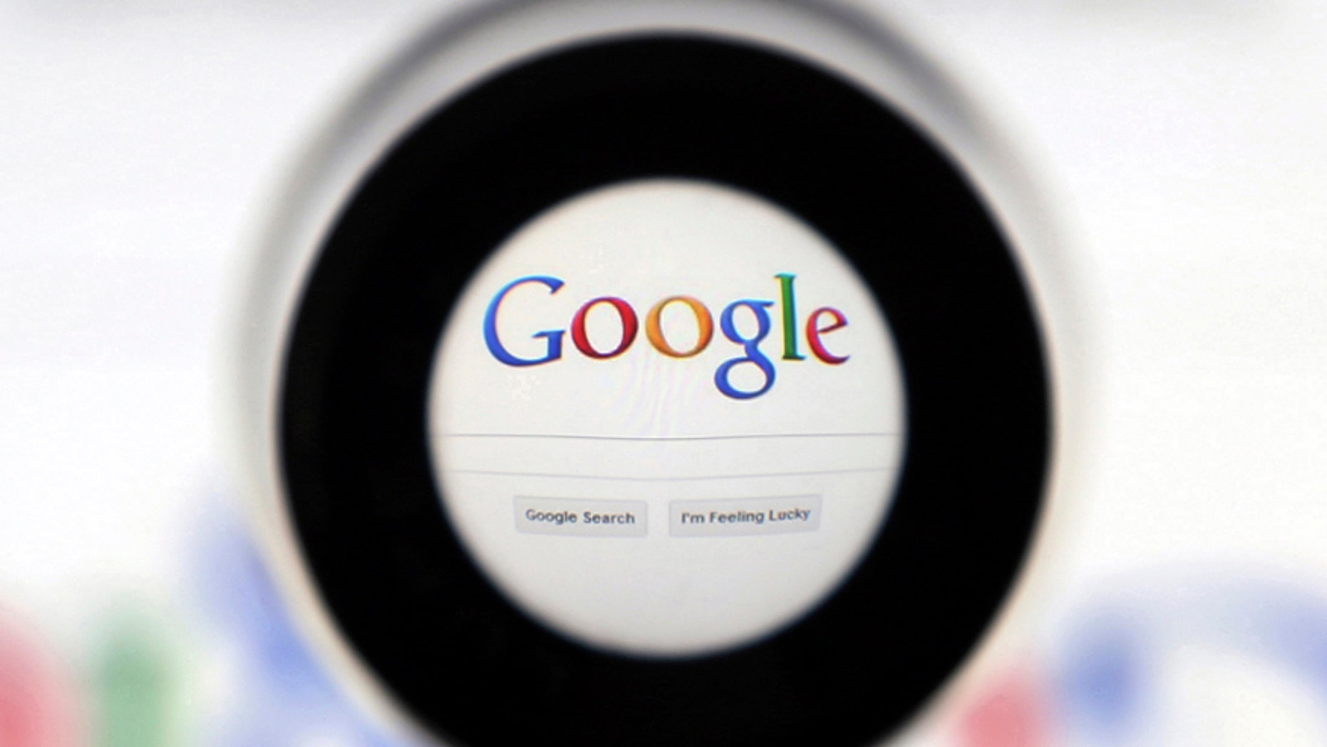 File photo - A Google search page is seen through a magnifying glass in this photo illustration taken in Brussels May 30, 2014. (REUTERS/Francois Lenoir)
