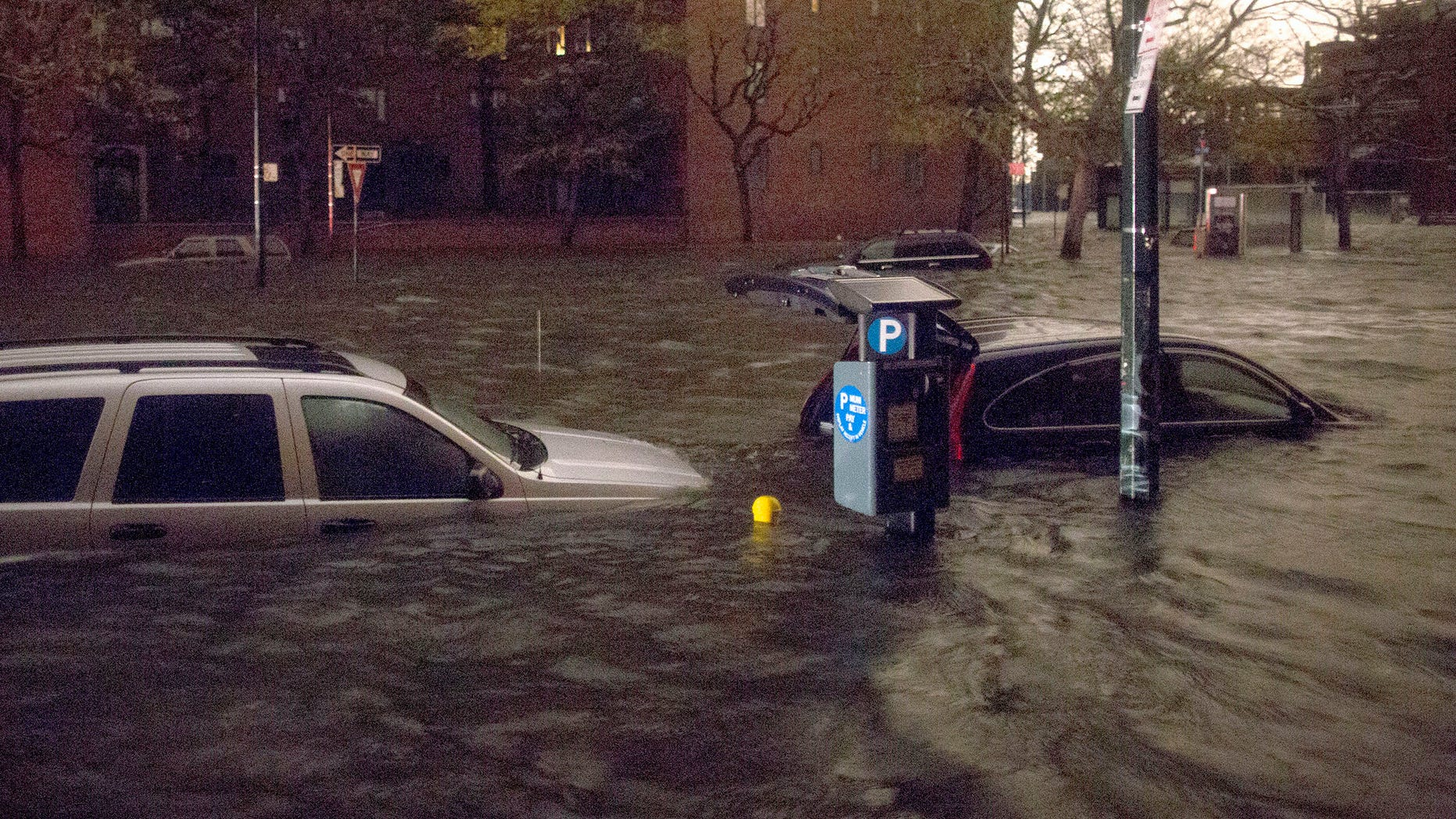 Oct. 29, 2012: Vehicles are submerged on 14th Street near the Consolidated Edison power plant Monday in New York City.