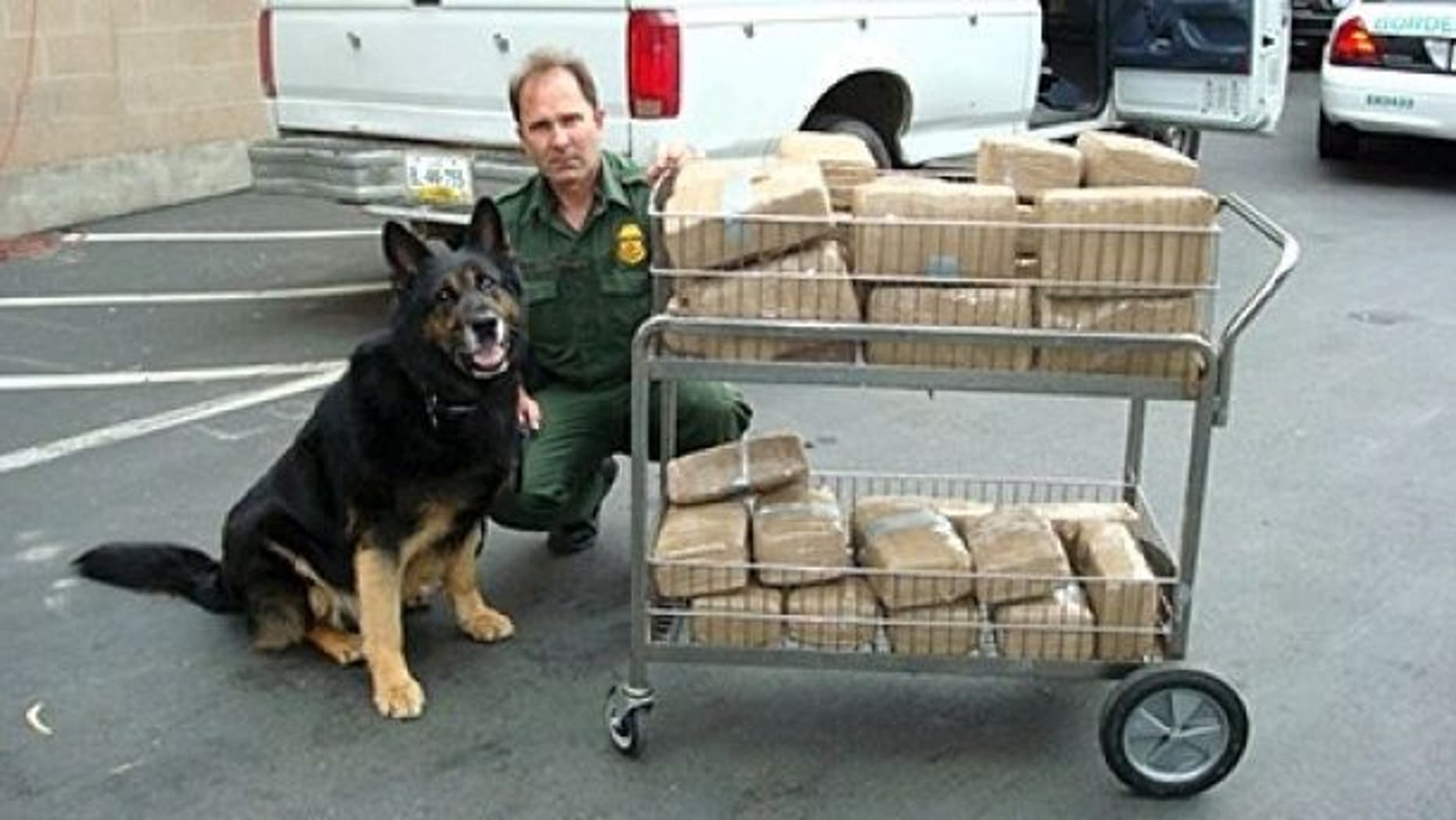 Supervisory Border Patrol Agent Peter Dame with K-9 Don.