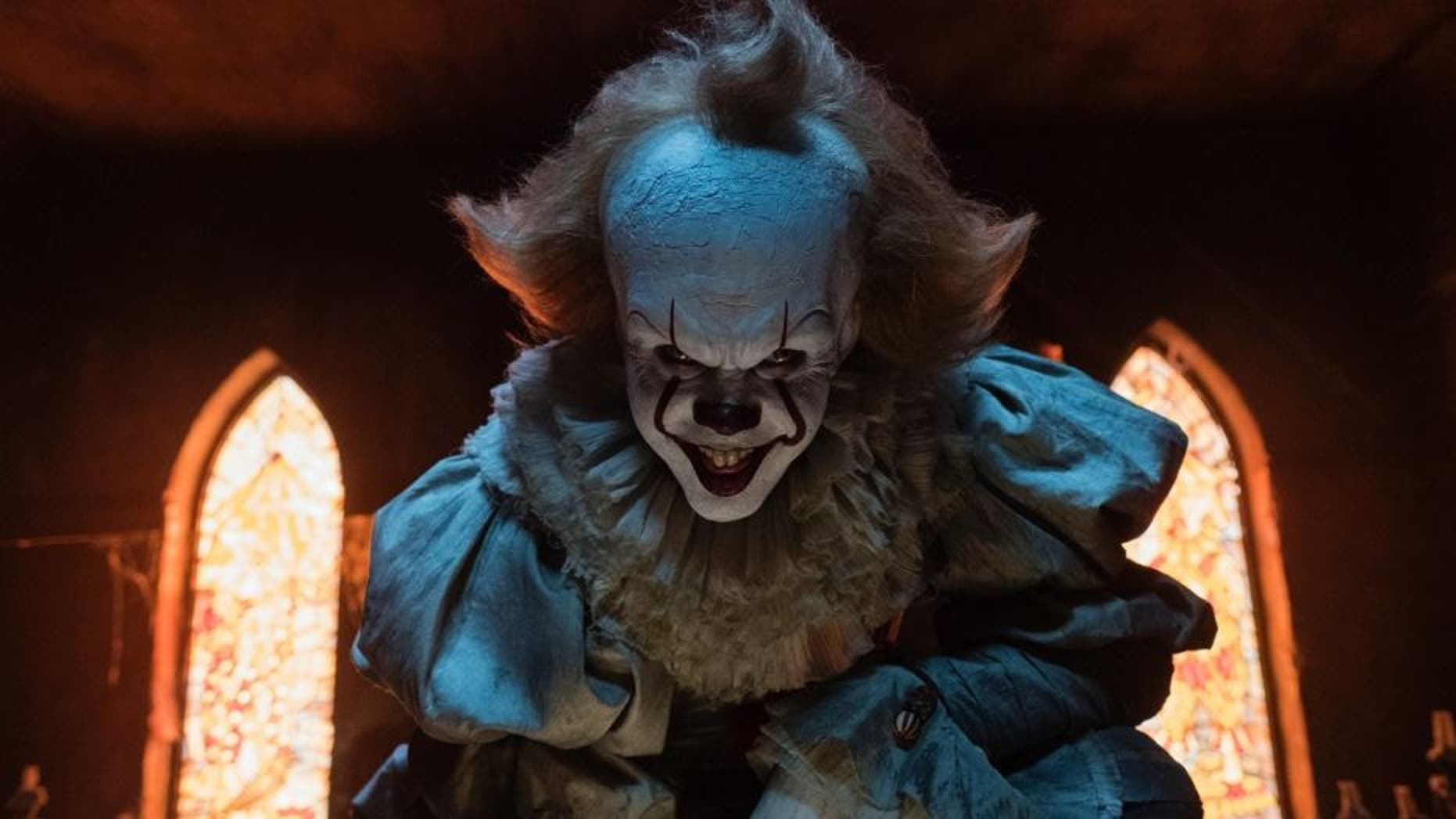 """Bill Skarsgard stars as Pennywise the clown in """"It,"""" a new horror film based on a Stephen King novel."""