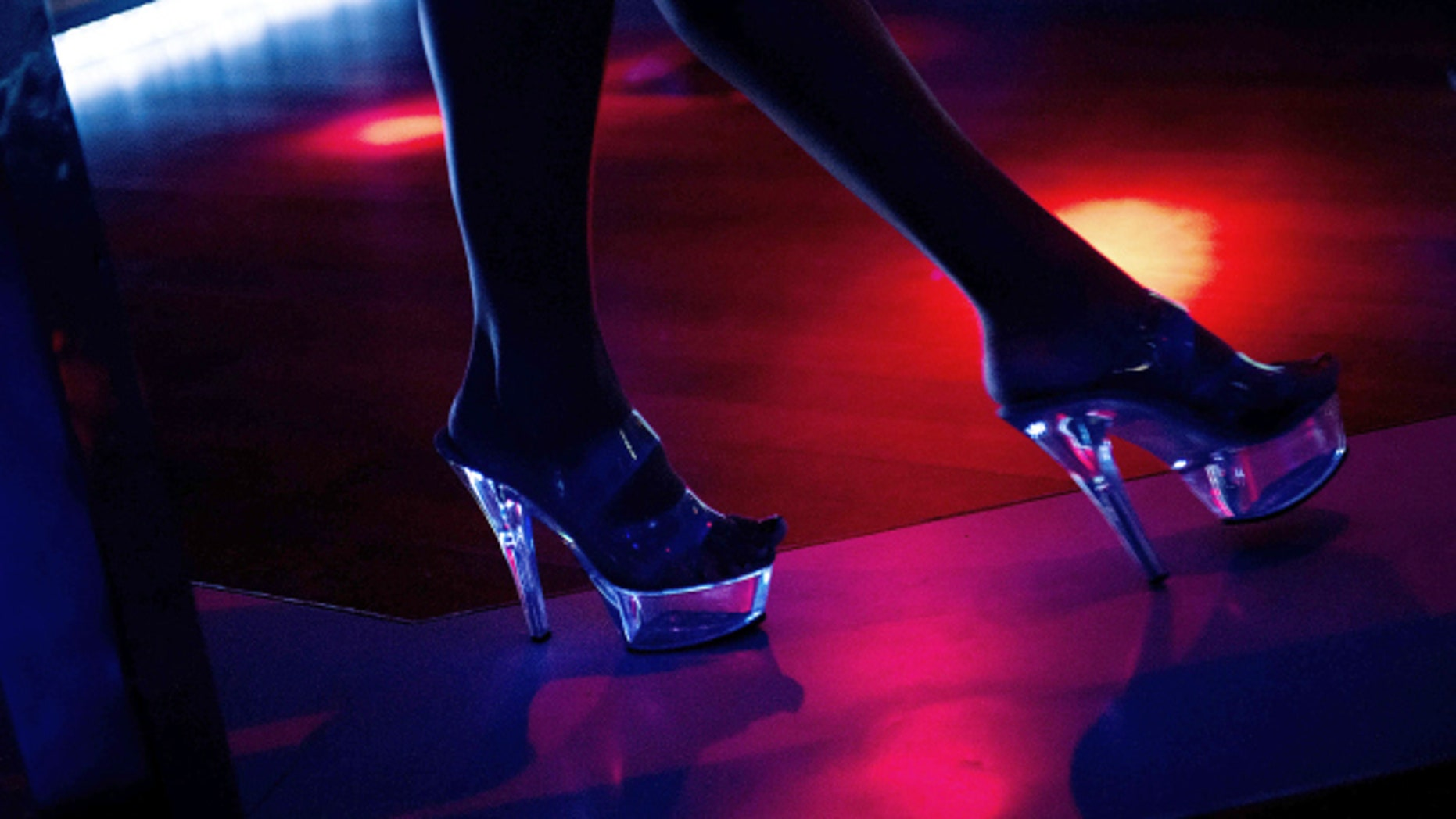 """A dancer performs at the Mons Venus Club on August 23, 2012 in Tampa, Florida. Despite only having 30 strip clubs Tampa has earned the title of """"Strip Club Capital of the World."""" The Republican Party will hold its 2012 national convention in Tampa, August 27-30.    AFP PHOTO/Brendan SMIALOWSKI        (Photo credit should read BRENDAN SMIALOWSKI/AFP/GettyImages)"""