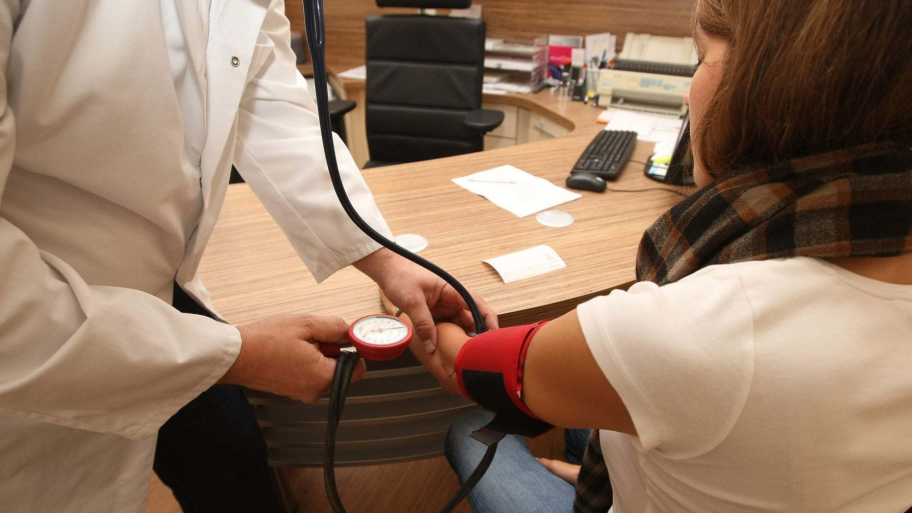 BERLIN, GERMANY - SEPTEMBER 05:  A doctor checks a patient's blood pressure on September 5, 2012 in Berlin, Germany. Doctors in the country are demanding higher payments from health insurance companies (Krankenkassen). Over 20 doctors' associations are expected to hold a vote this week over possible strikes and temporary closings of their practices if assurances that a requested additional annual increase of 3.5 billion euros (4,390,475,550 USD) in payments are not provided. The Kassenaerztlichen Bundesvereinigung (KBV), the National Association of Statutory Health Insurance Physicians, unexpectedly broke off talks with the health insurance companies on Monday.  (Photo by Adam Berry/Getty Images)