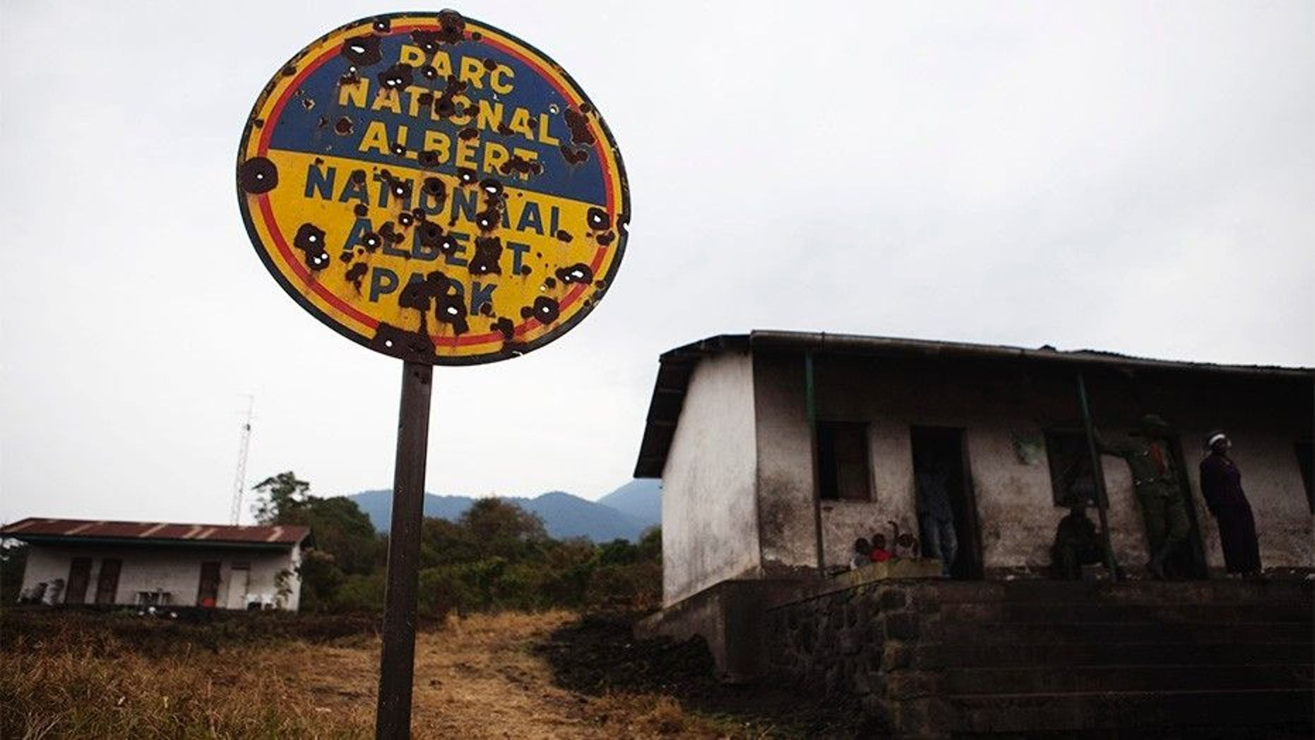 A bullet riddled sign marks the entrance to Virunga National Park, occupied by rebels and other armed militias during years of conflict near Goma in eastern Congo. (Reuters)