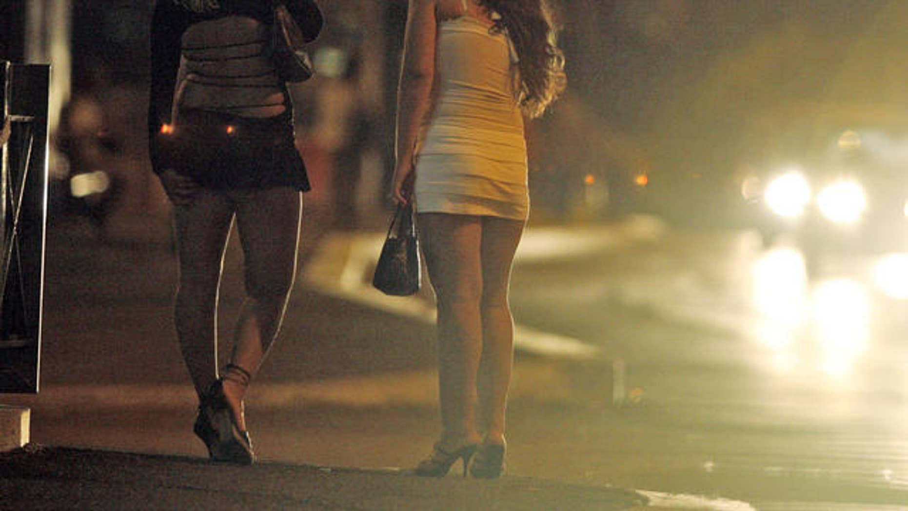 Prostitutes are seen in Rome in this July 3, 2007 photo.  Italian law gives foreign prostitutes a chance to escape human traffickers who force young women from poor countries to sell their bodies to pay for their passage into Western Europe. While some other European nations also have laws to help trafficked prostitutes, Italy's legislation stands out because of its elasticity: Women are encouraged, but not required, to testify against their traffickers.    (AP Photo/Andrew Medichini)