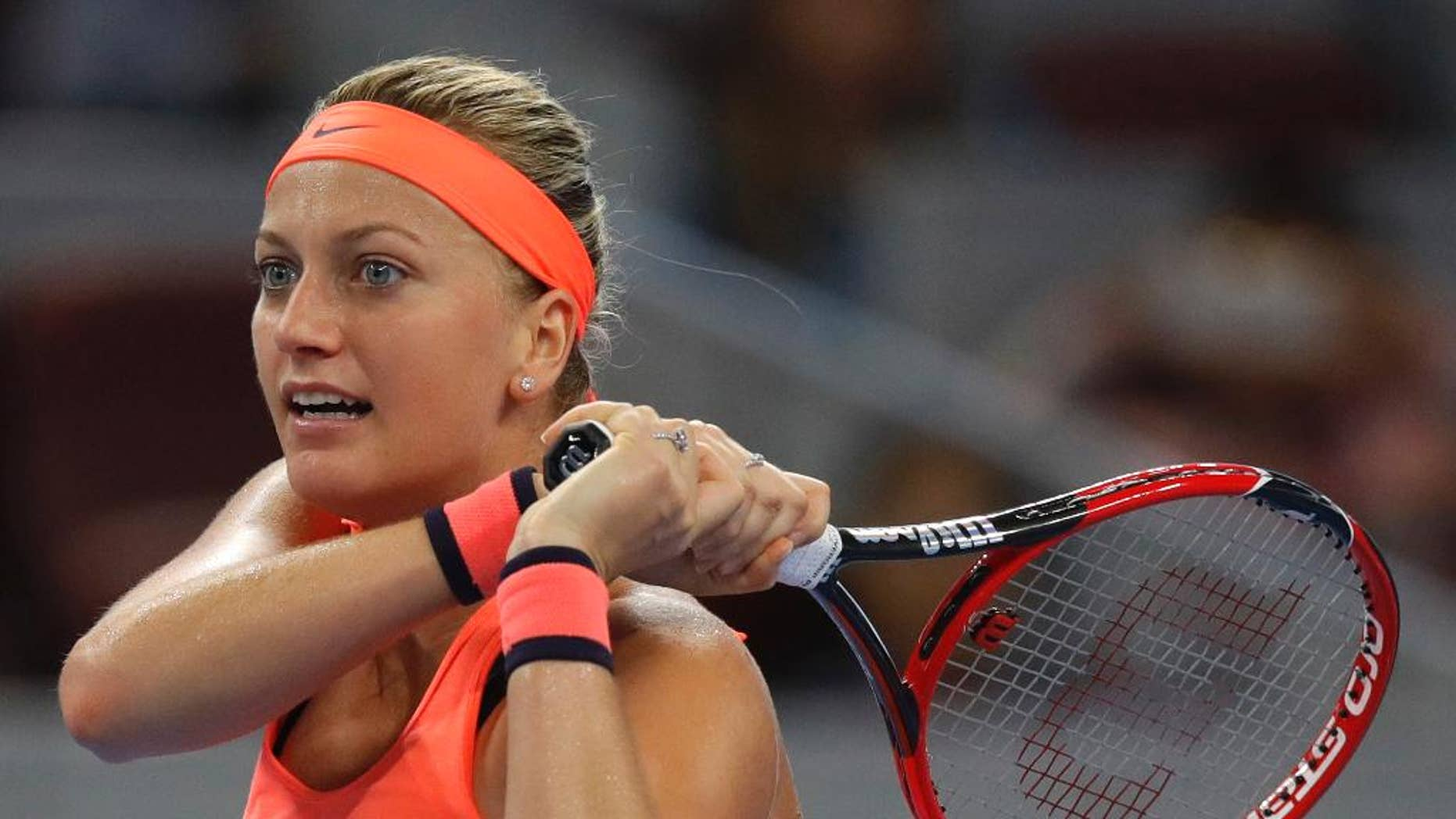 FILE - In this Oct. 4, 2016, file photo, Petra Kvitova, of the Czech Republic, watches her shot during her women's singles match against Wang Yafan of China at the China Open tennis tournament in Beijing. Two-time Wimbledon champion Petra Kvitova is back at practice, less than six months after being attacked by a knife-wielding intruder. Kvitova posted a photo on Instagram on Tuesday, May 2, 2017, showing herself swinging a tennis racket. (AP Photo/Andy Wong, File)