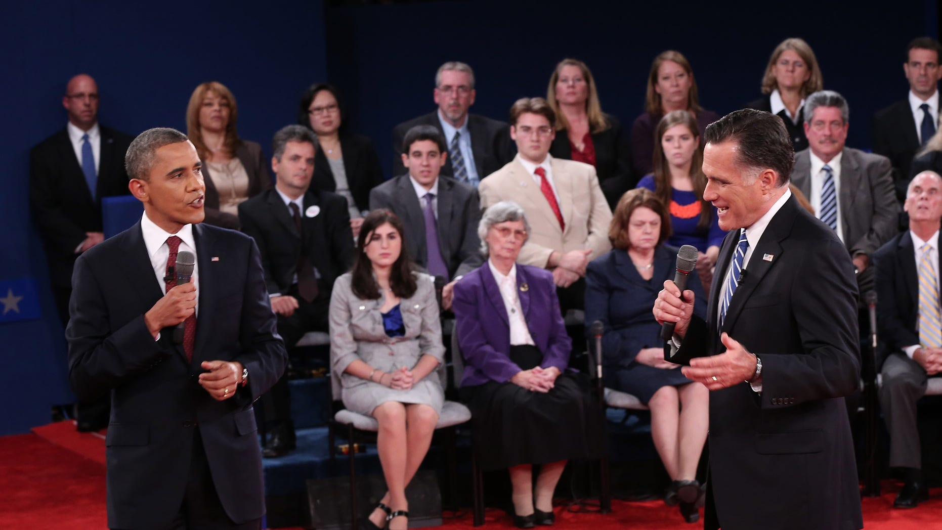 HEMPSTEAD, NY - OCTOBER 16: U.S. President Barack Obama (L) debates Republican presidential candidate Mitt Romney (R) during a town hall style meeting at Hofstra University October 16, 2012 in Hempstead, New York. During the second of three presidential debates, the candidates fielded questions from audience members on a wide variety of issues. (Photo by Win McNamee/Getty Images)
